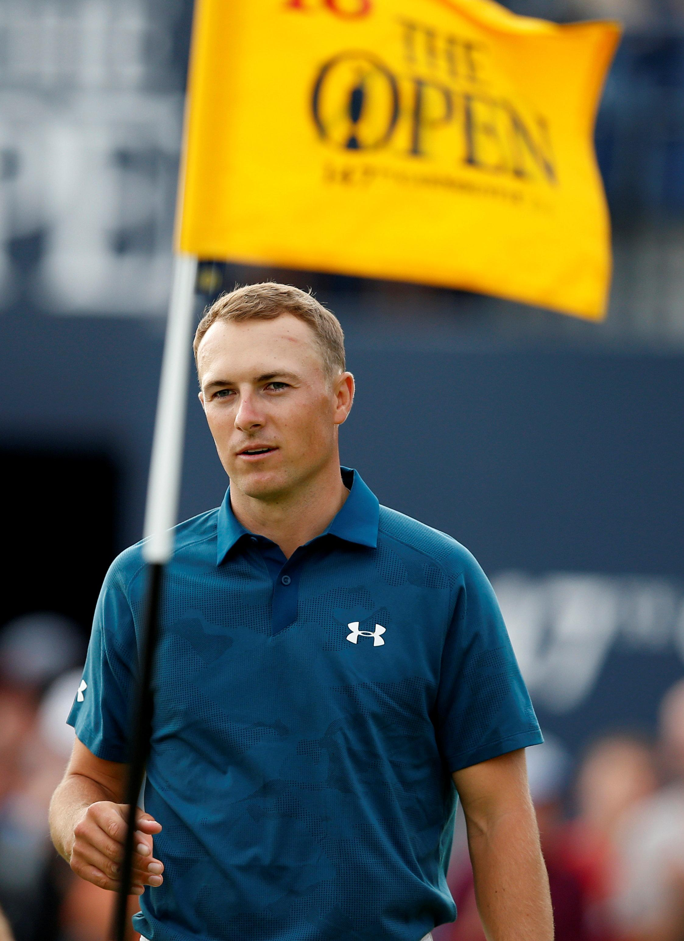 Jordan Spieth laughed off his 'very British' haircut after trimming the competition down to size at the Open