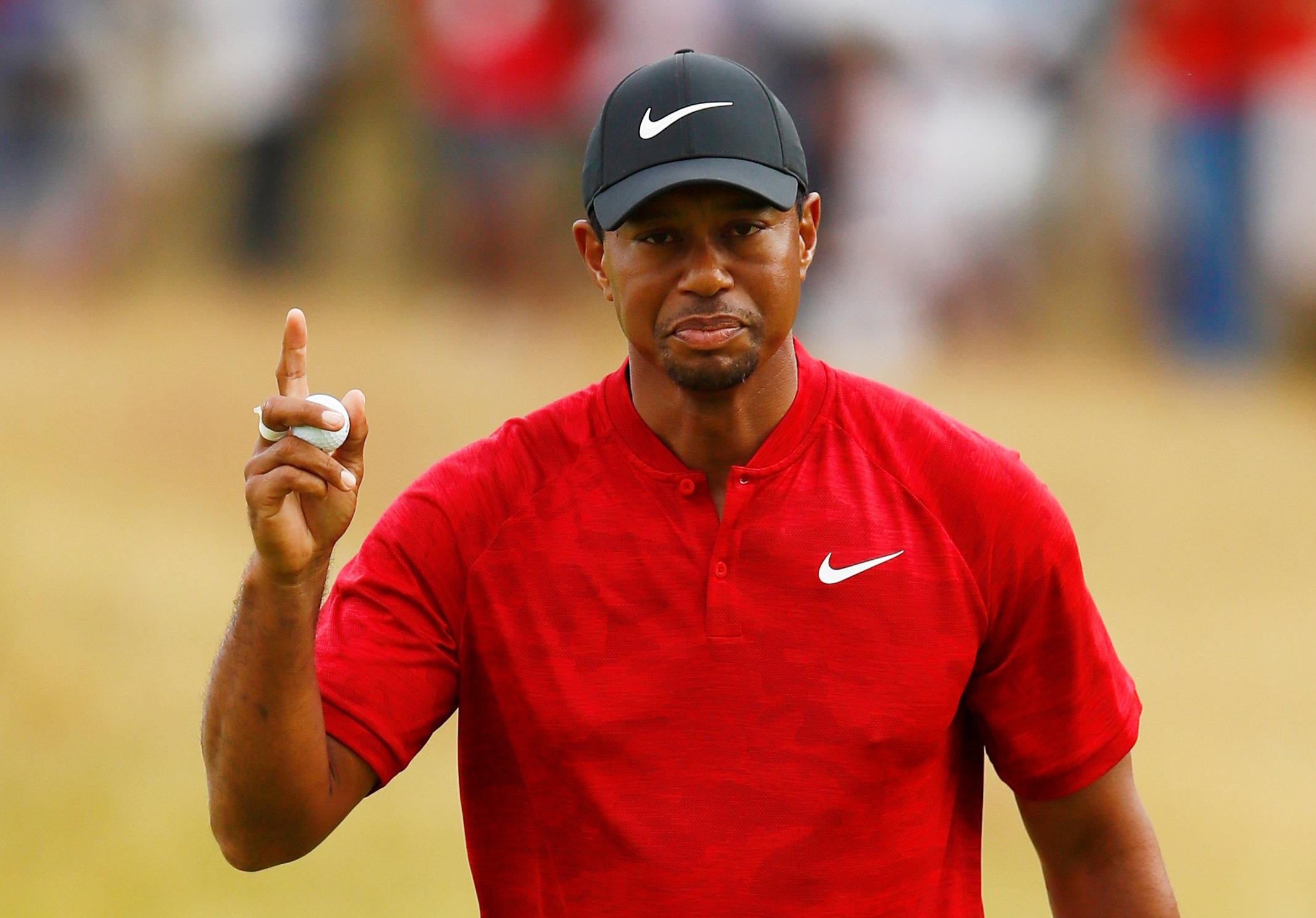 Tiger Woods has hit out at a heckler after he attempted to distract him at the 18th hole