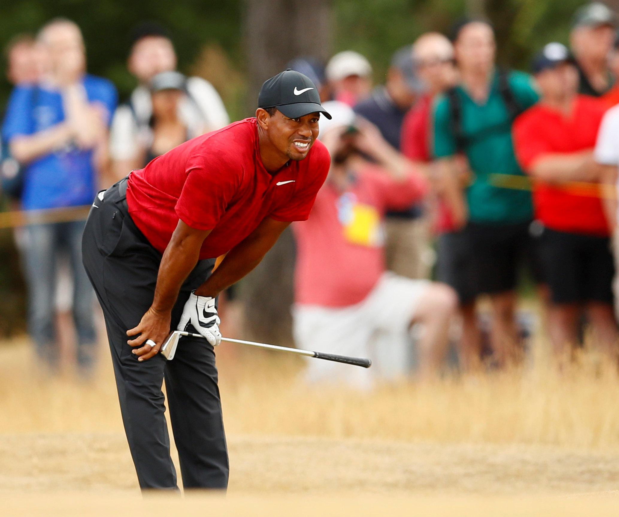 Woods, 42, remains in contention to win his first major since the US Open in 2008