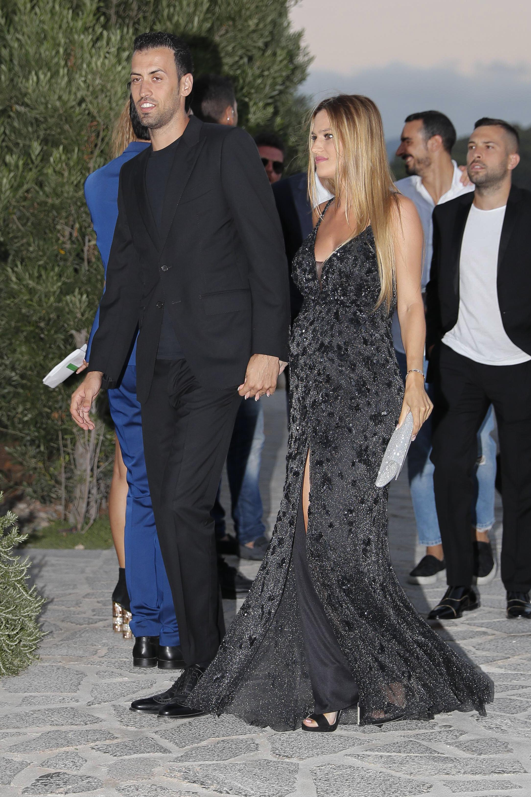 Sergio Busquets and wife Elena Galera look in happy spirits as they get ready to party with Cesc Fabregas