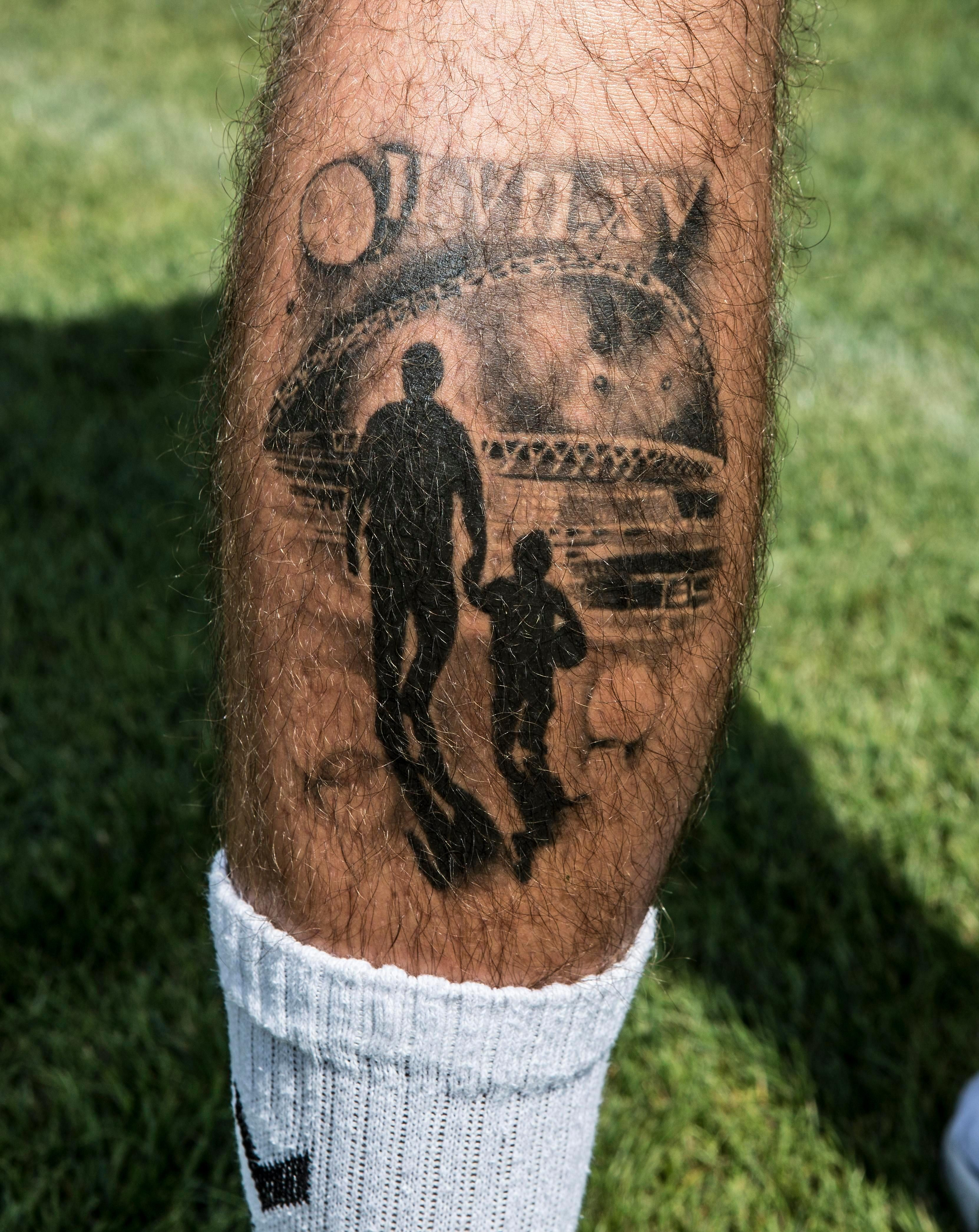 The tattoos shows a silhouette of Page and his father walking towards Wembley