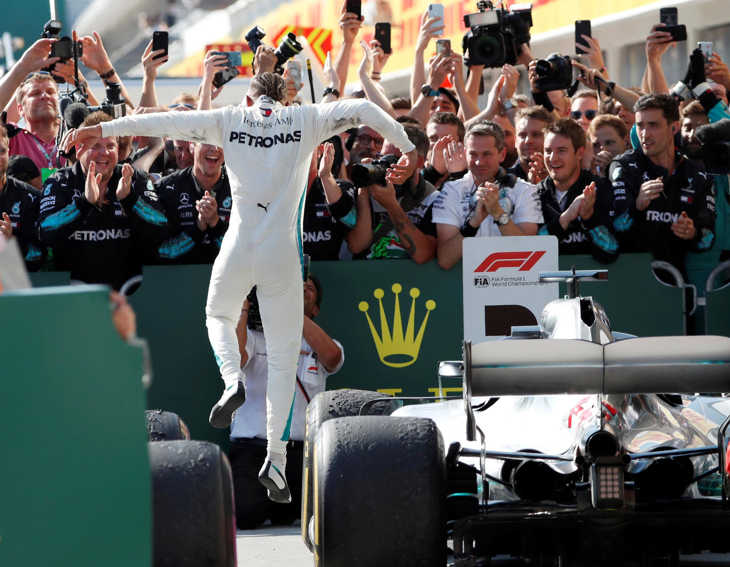 Hamilton jumps for joy after his victory in Budapest on Sunday