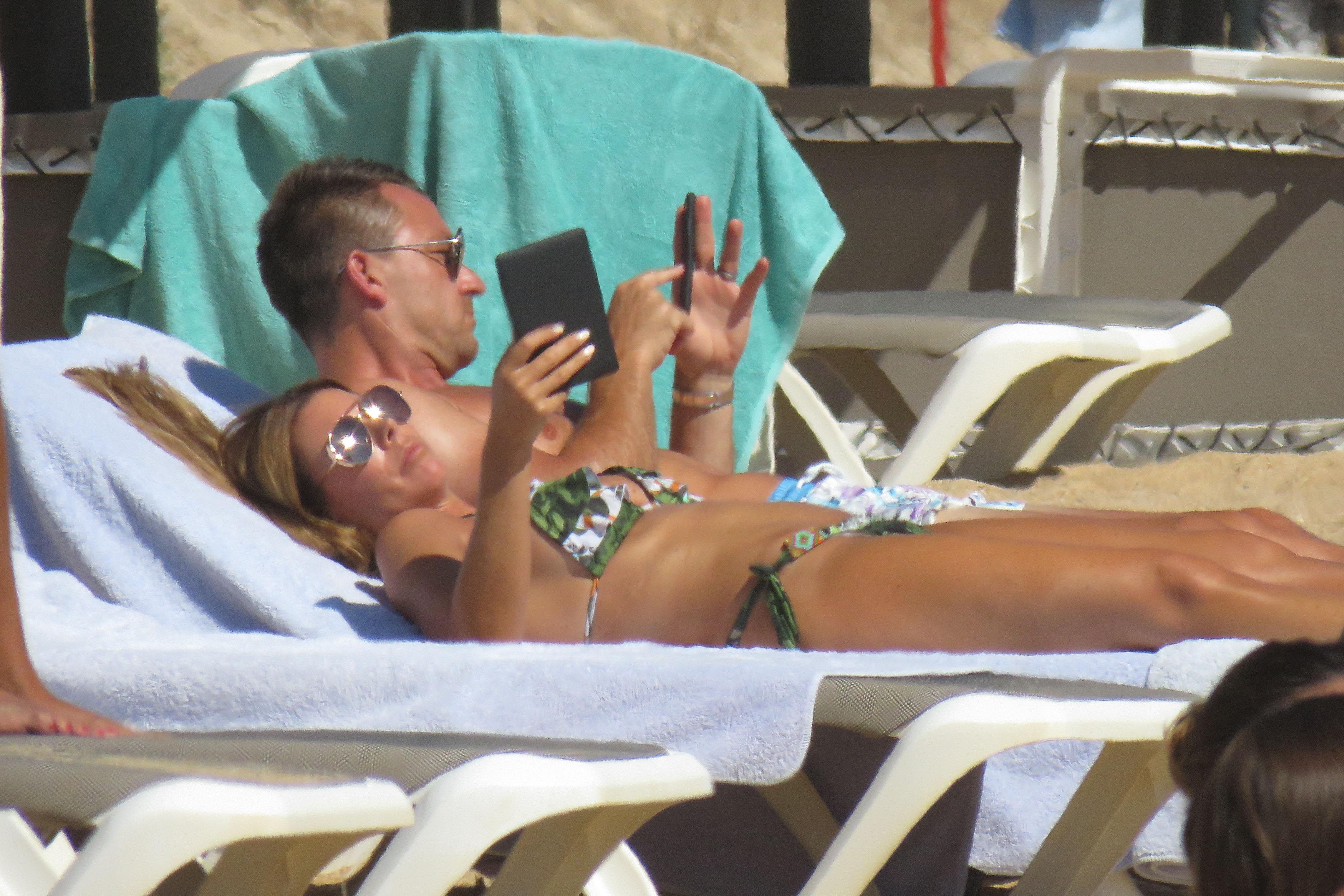 The couple relaxed on the sunbeds during their holiday in Portugal