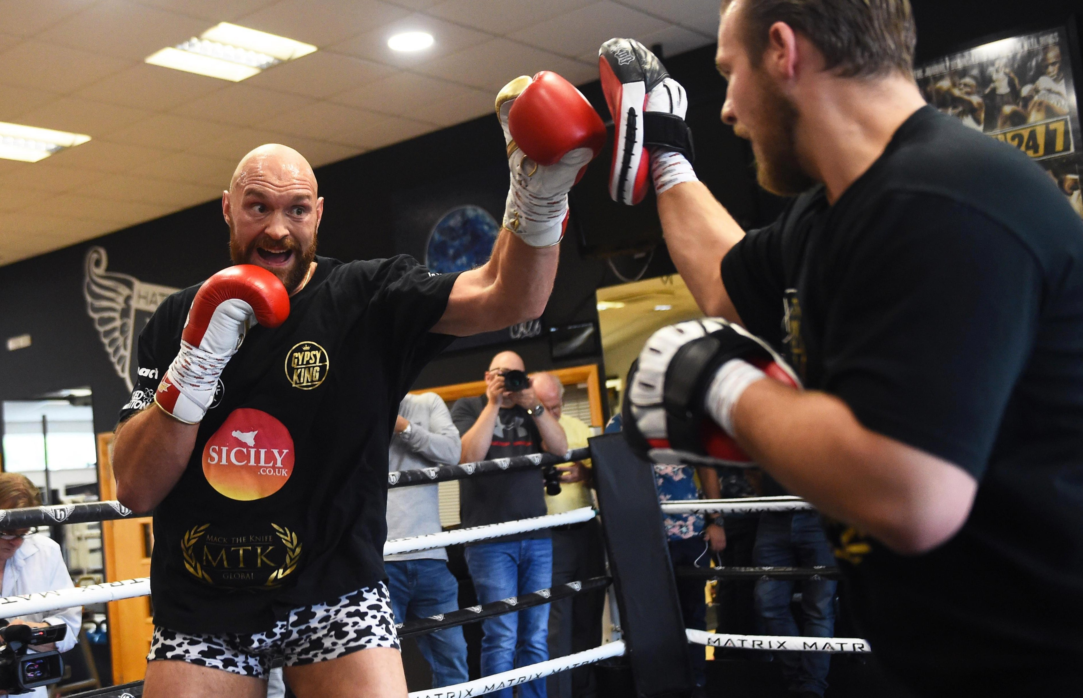 Fury trains during a media workout at Hatton Health & Fitness on July 31