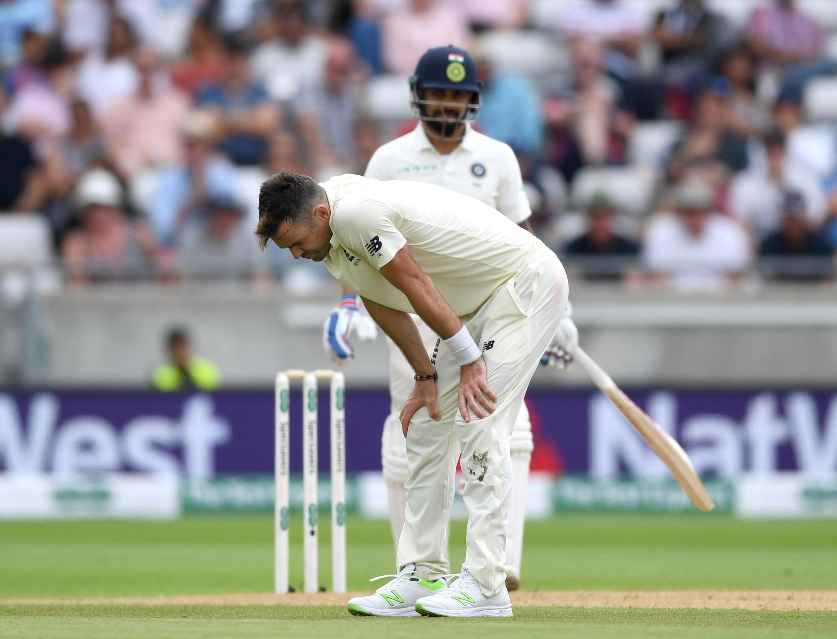 James Anderson shows the disappointment of seeing the prize wicket of Virat Kohli go begging