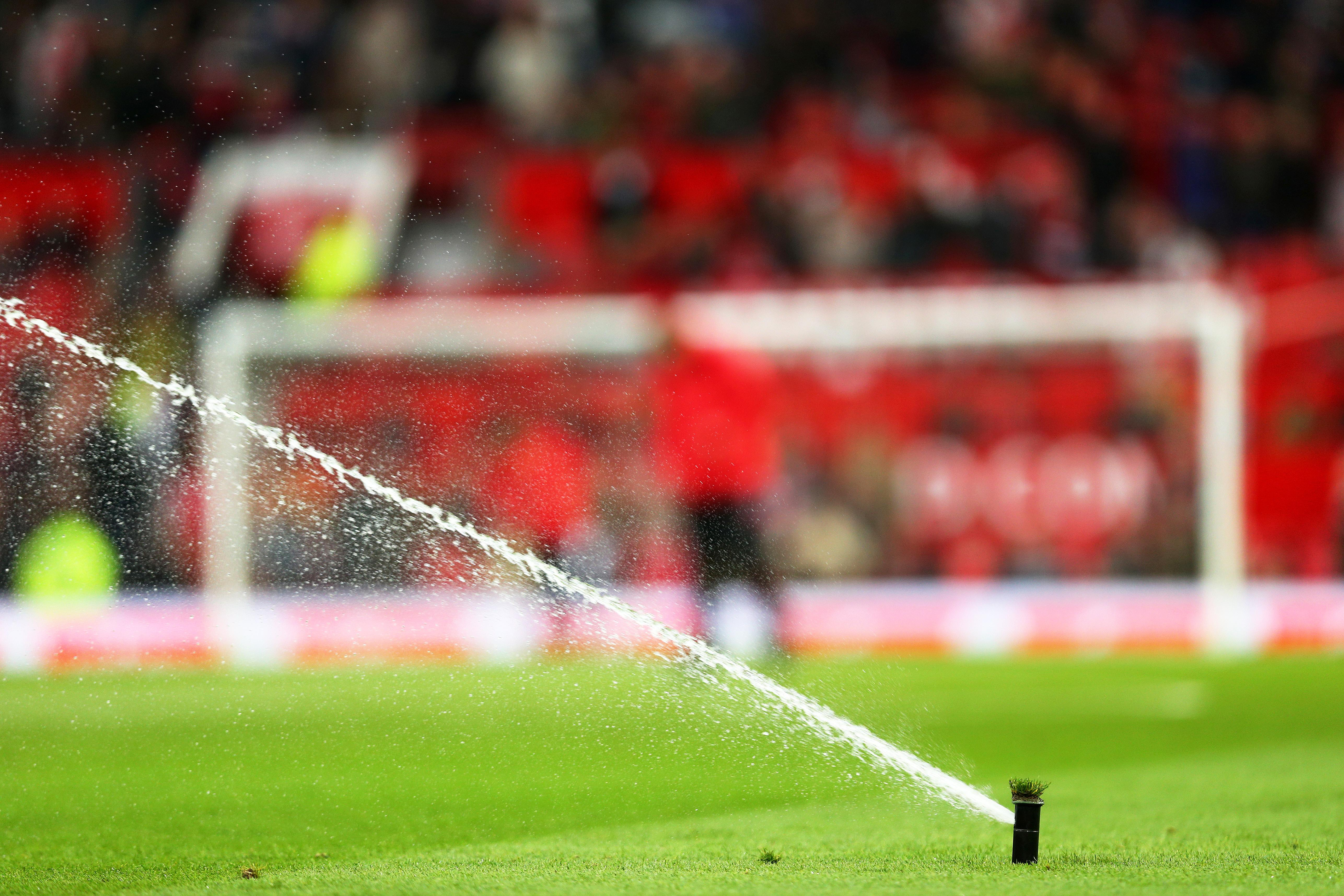 Kettering Town have used 30,000 litres of water to try and make the pitch safe