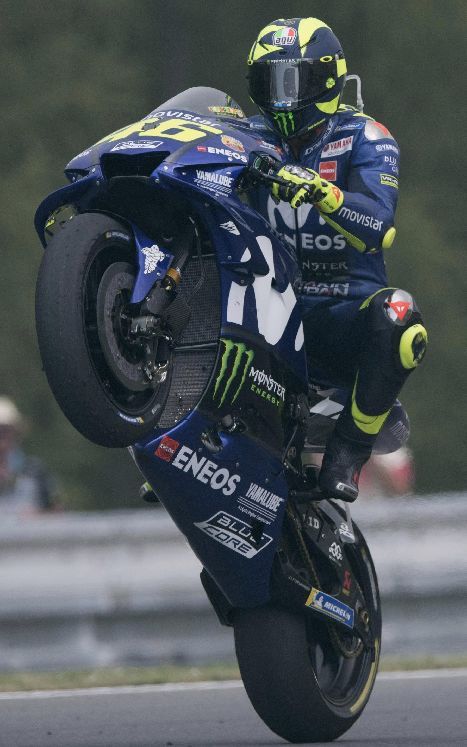 Nine-time world champion Valentino Rossi does a wheelie after finishing fourth in Brno