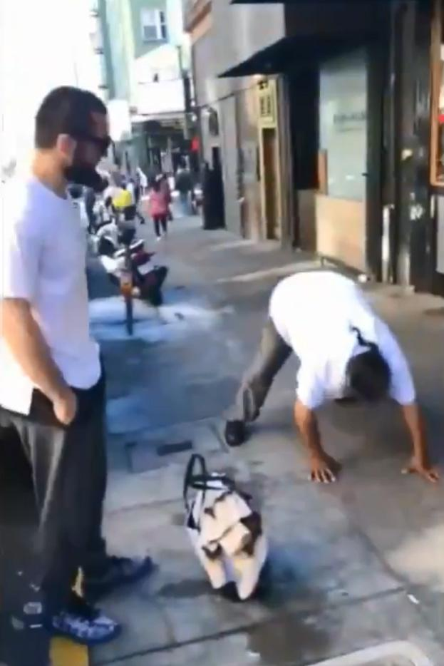 Another man then decides he fancies some extra cash and gets down for some push-ups