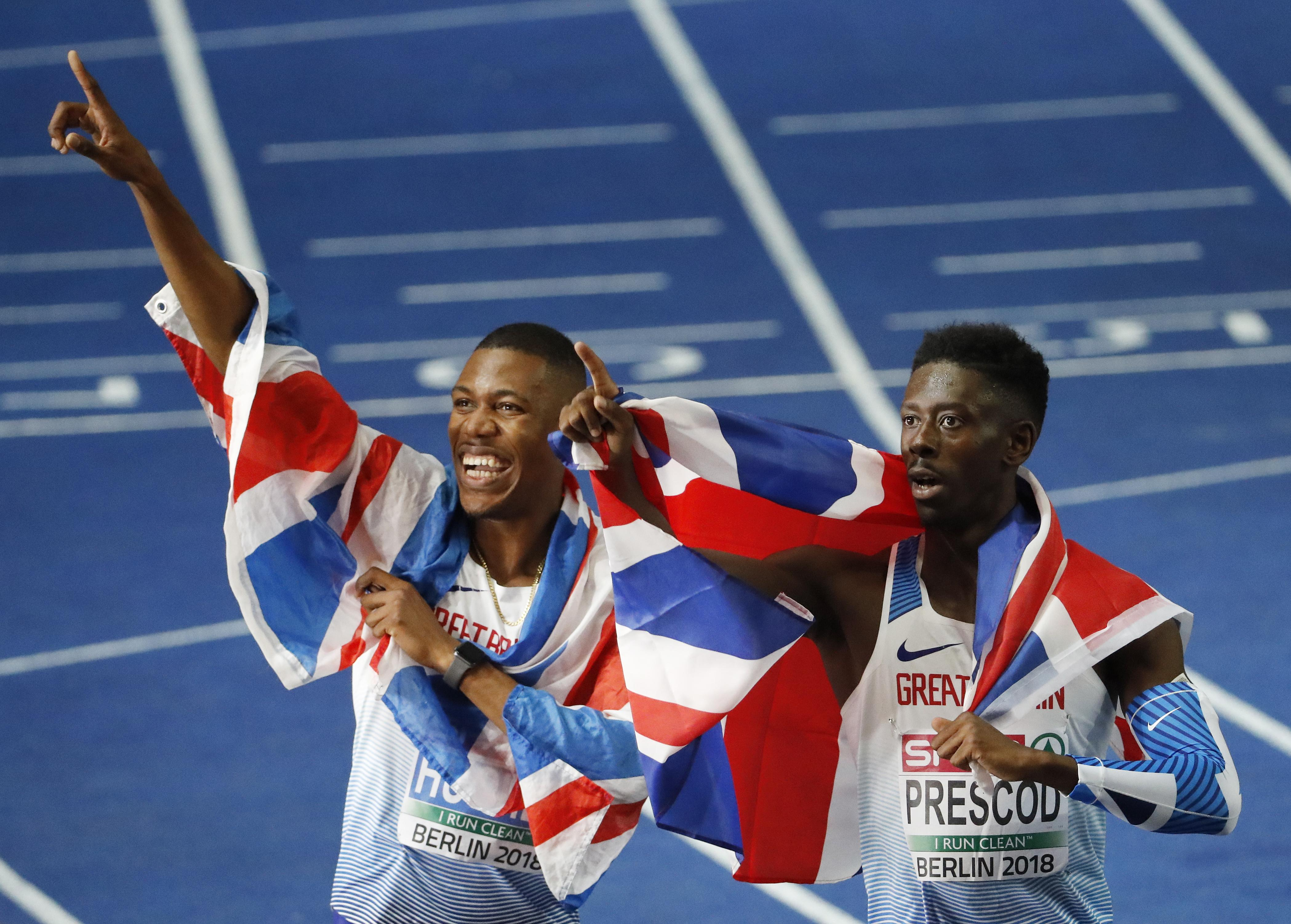 Hughes and Prescod celebrated together with Union Jacks over their shoulders