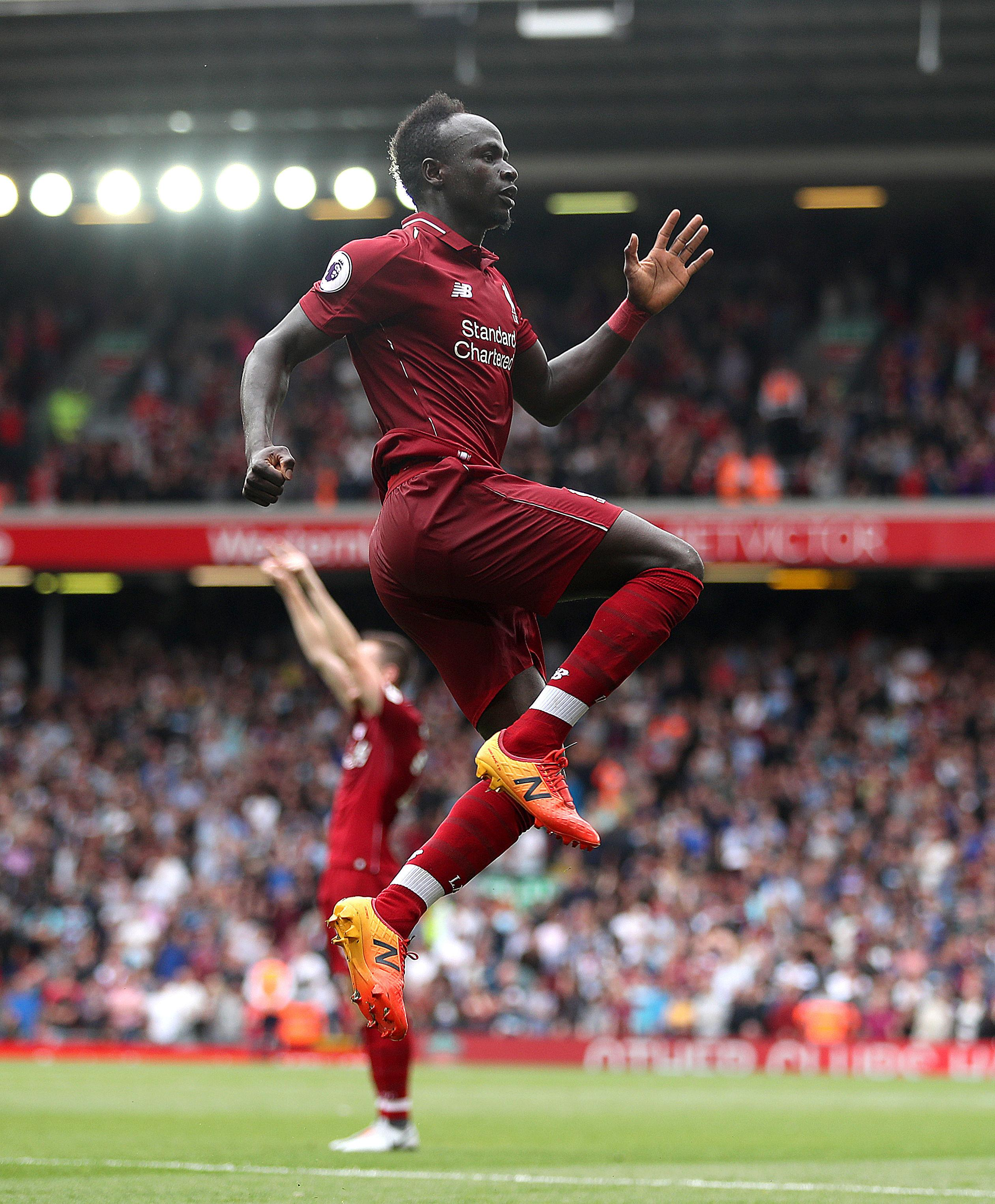 Sadio Mane scored twice in an easy first win of the season for Liverpool