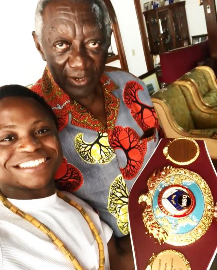 Ex-president John Kofi Agyekum Kufuor met with the beaming champion