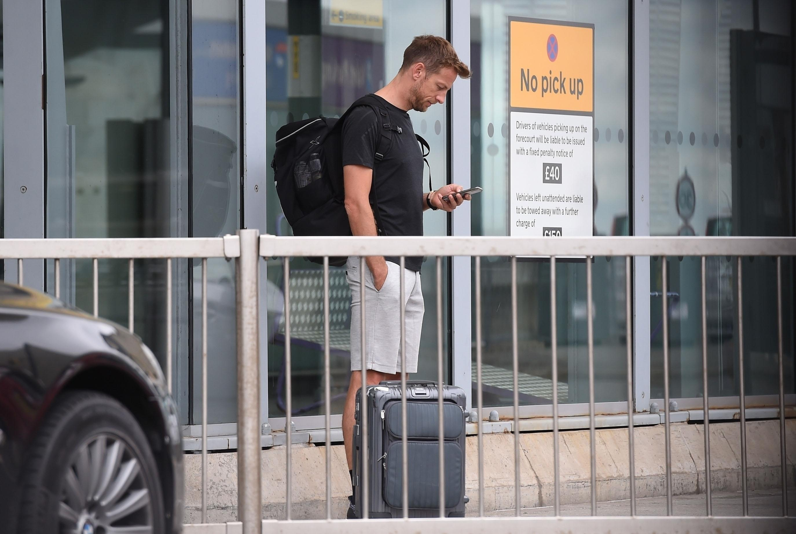 Jenson Button waits for his special delivery