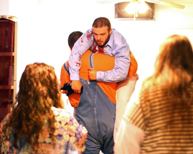 Cody Coots had to be carried out by his friend Cody Wynn after the attack at the Full Gospel Tabernacle in Jesus Name