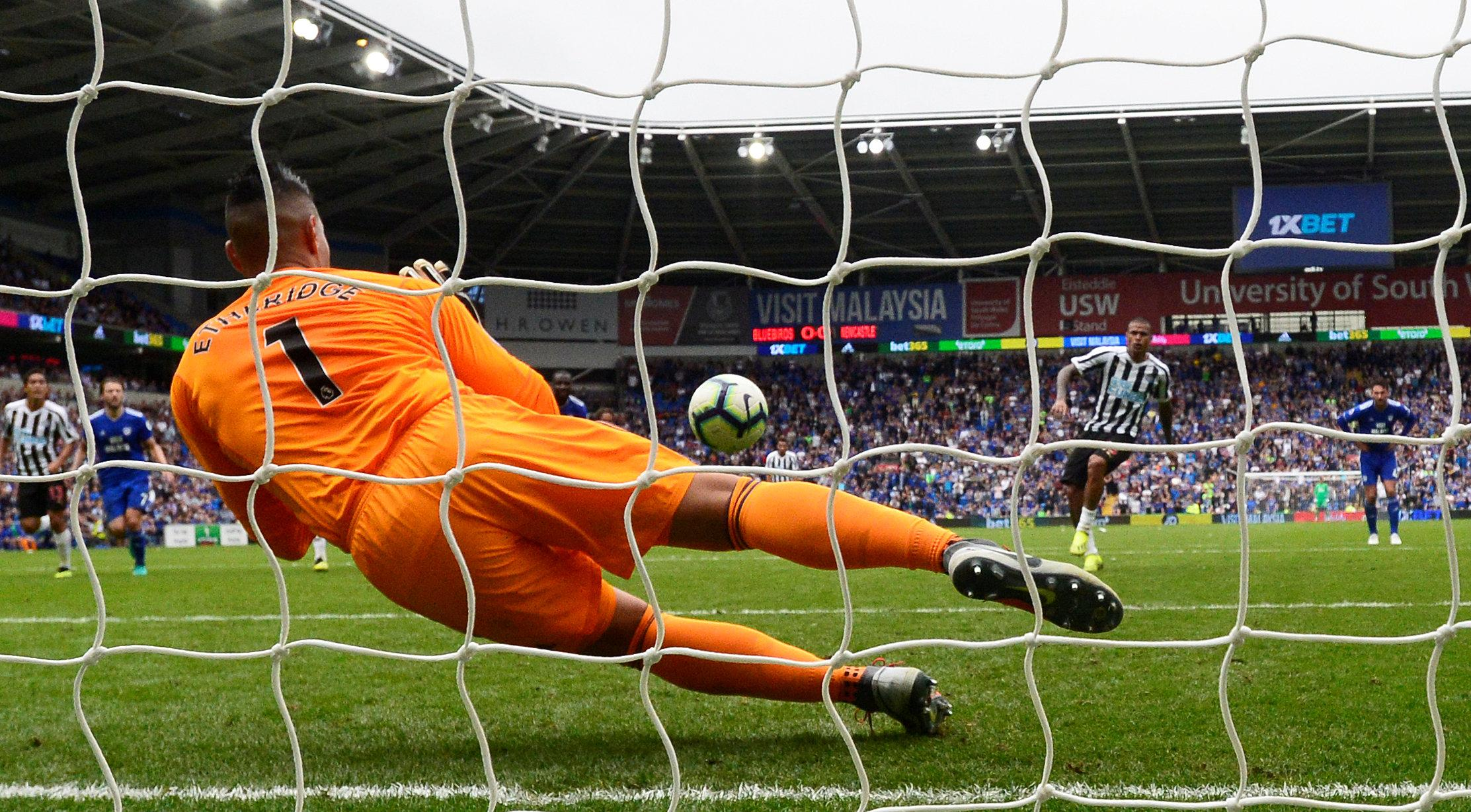 Neil Etheridge dives to save Kenedy's lame penalty