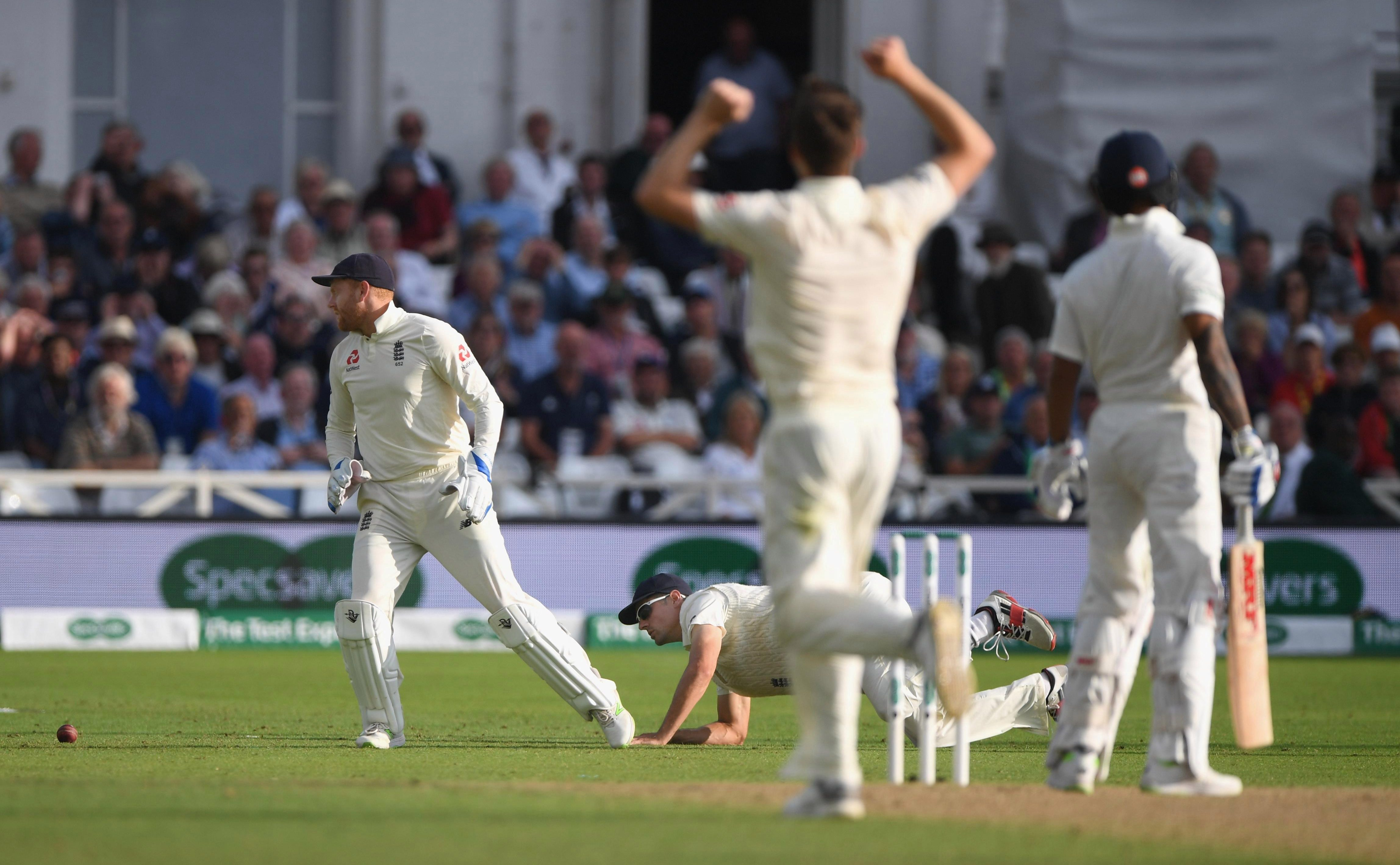 Alastair Cook drops a catch at slip to the disappointment of bowler Chris Woakes