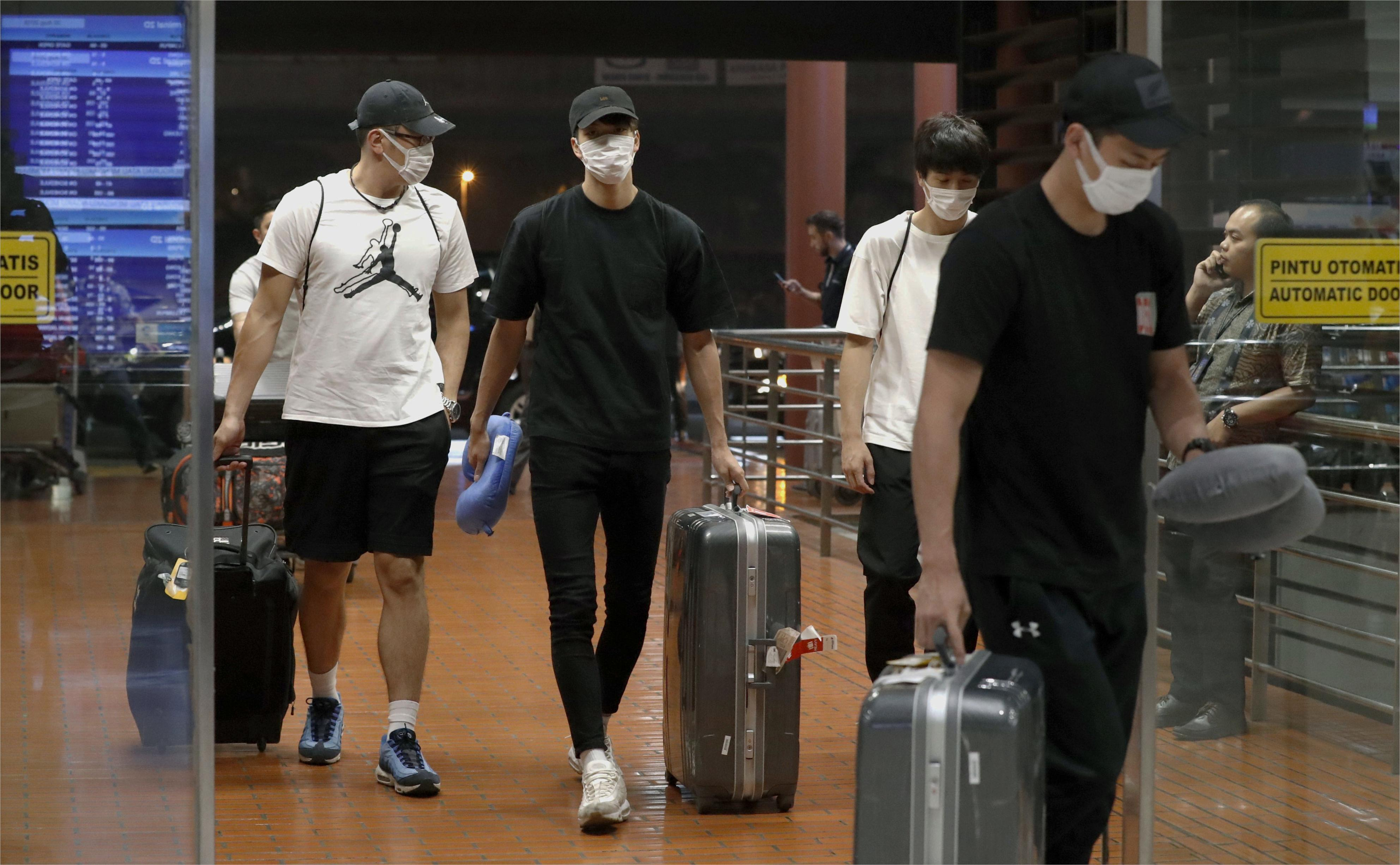 Four Japanese players at Jakarta airport after being sent home