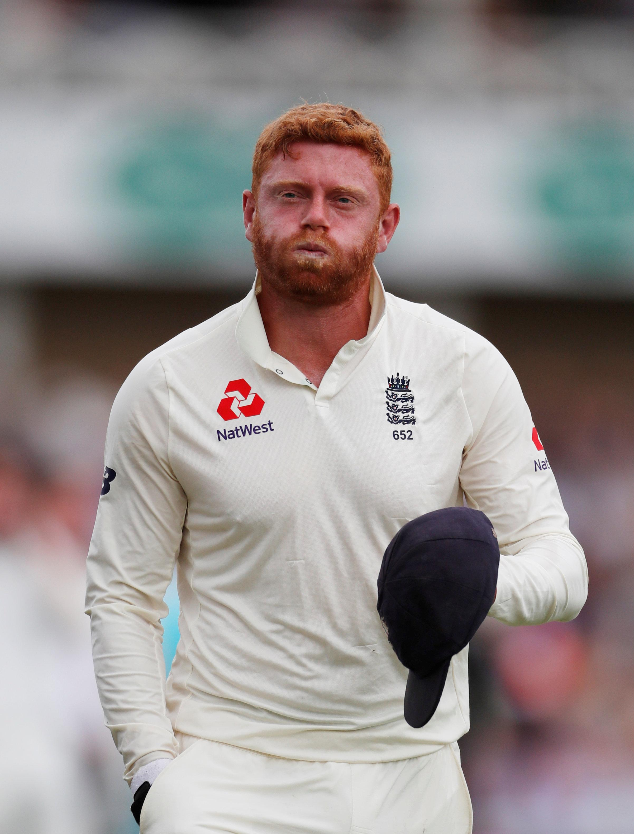 Jonny Bairstow grimaces in pain after suffering a fractured finger