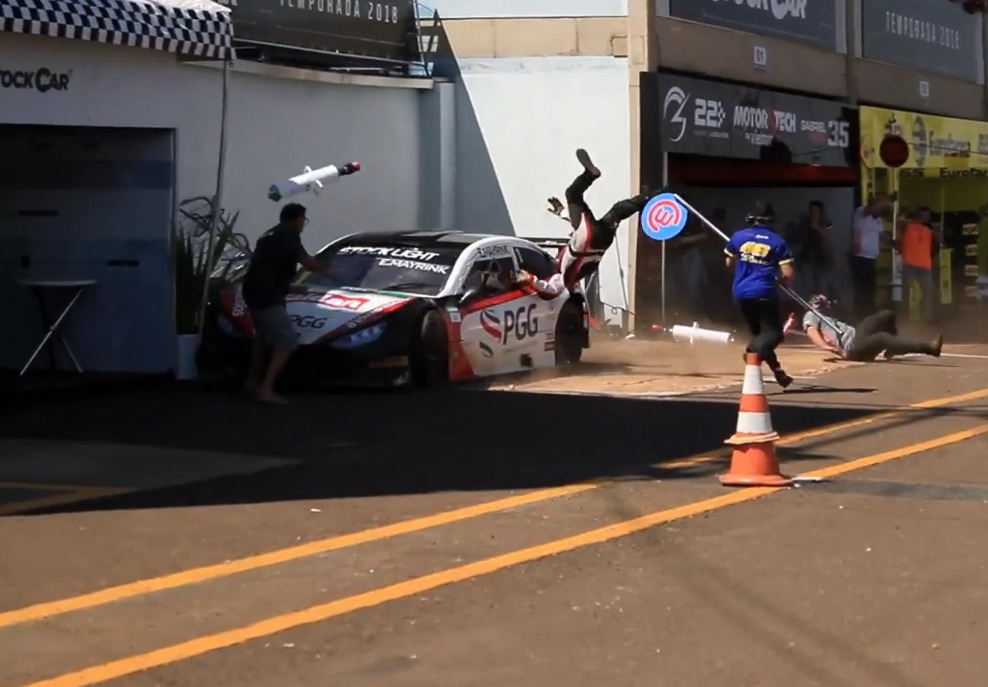 Mechanics were sent flying into the air after this horror crash