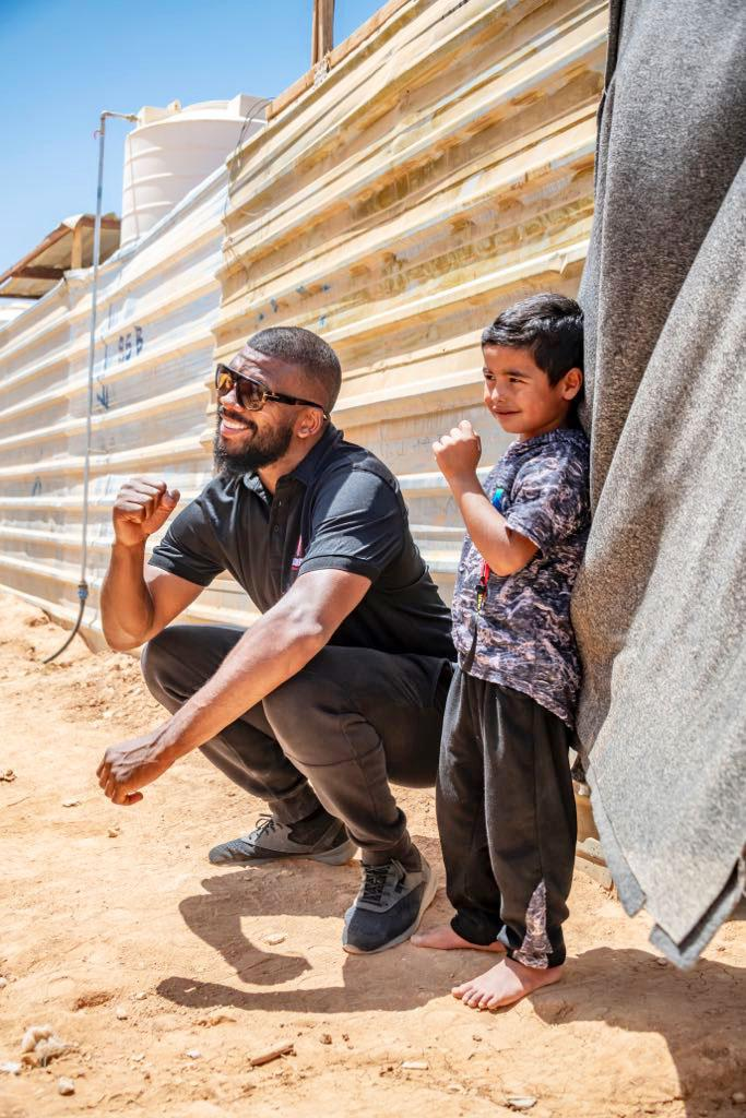 The two-weight boxing superstar is compelled to help refugee children