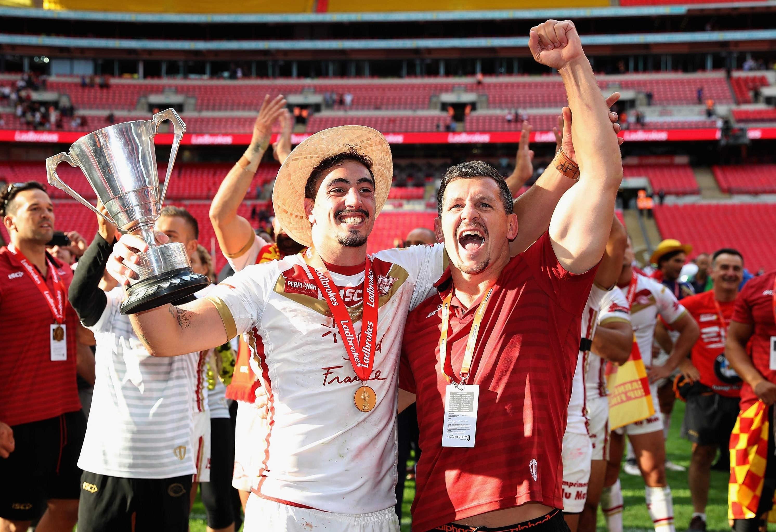 Tony Gigot and Greg Bird celebrate a first trophy for the club