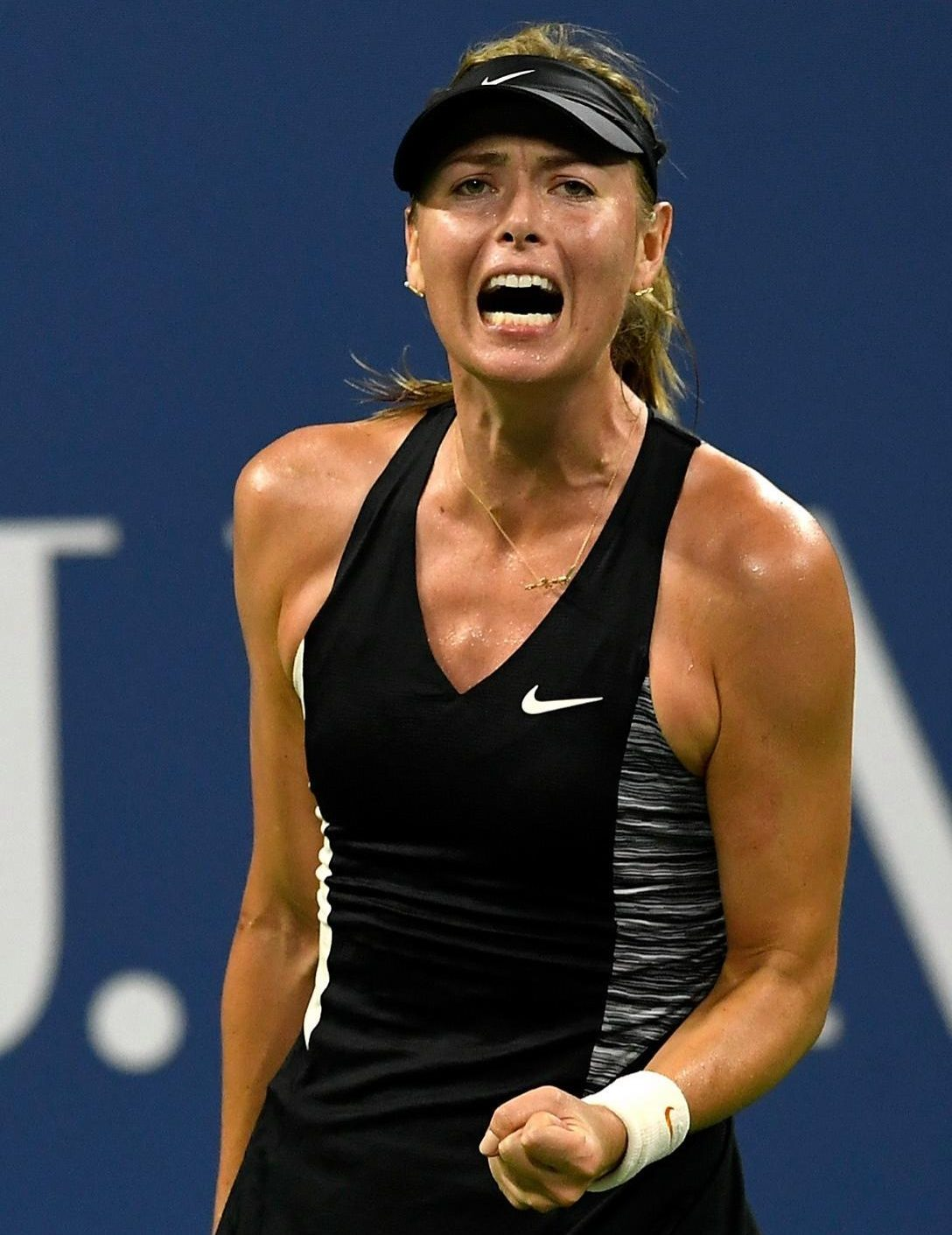 Russian beauty Maria Sharapova celebrates victory at Flushing Meadow