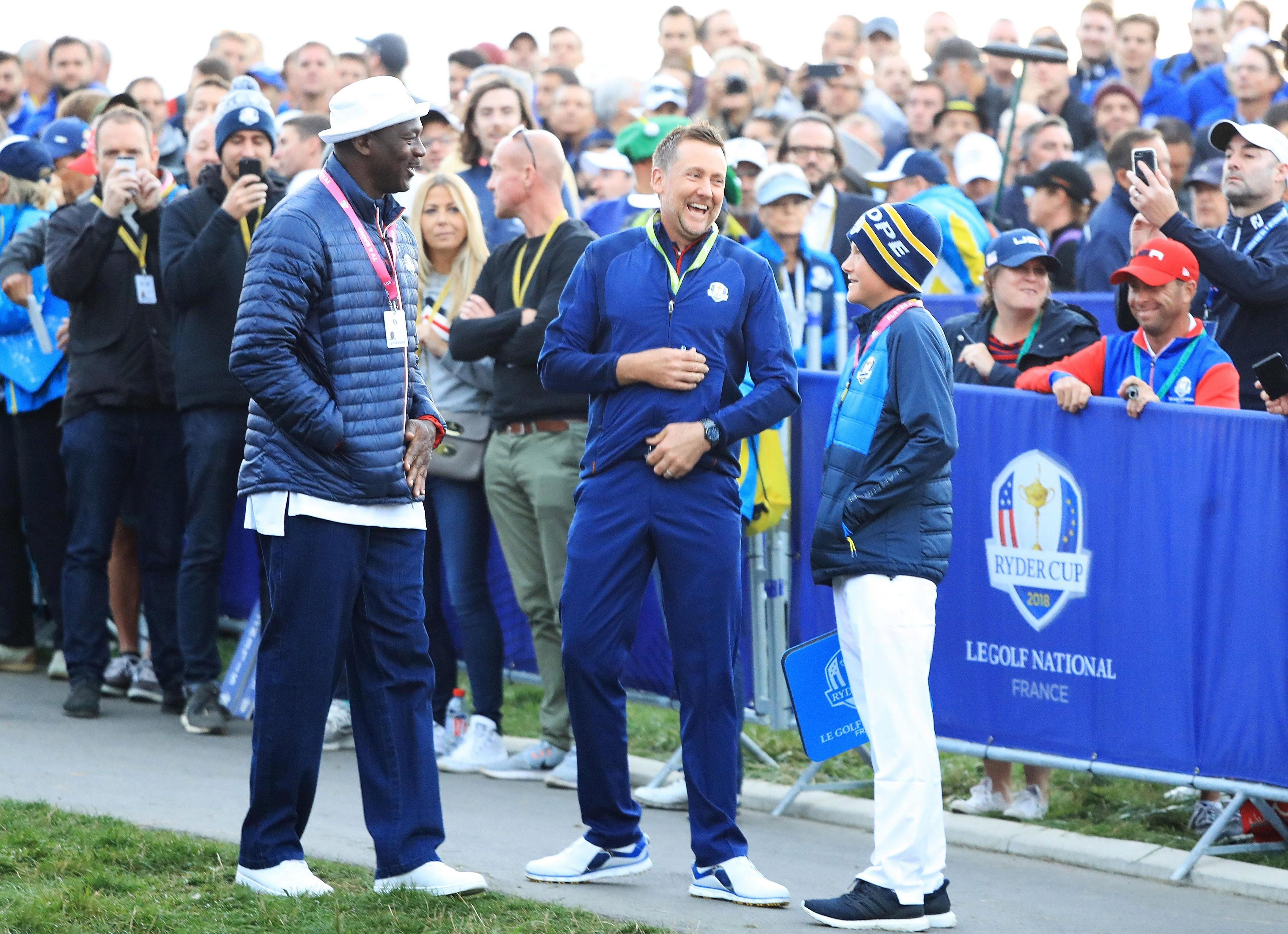 Michael Jordan greets Ian Poulter on the first tee at the Ryder Cup