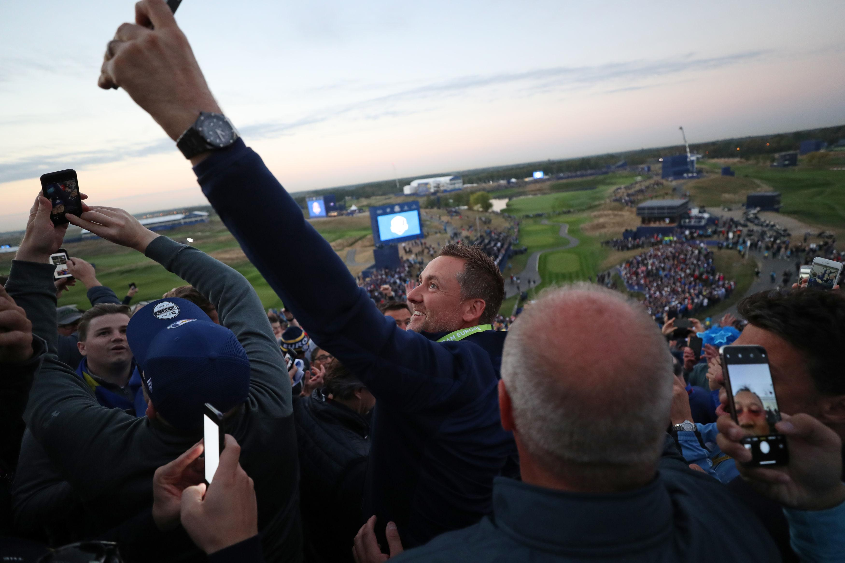 The Ryder Cup legend was at the top of the grandstand on the first tee