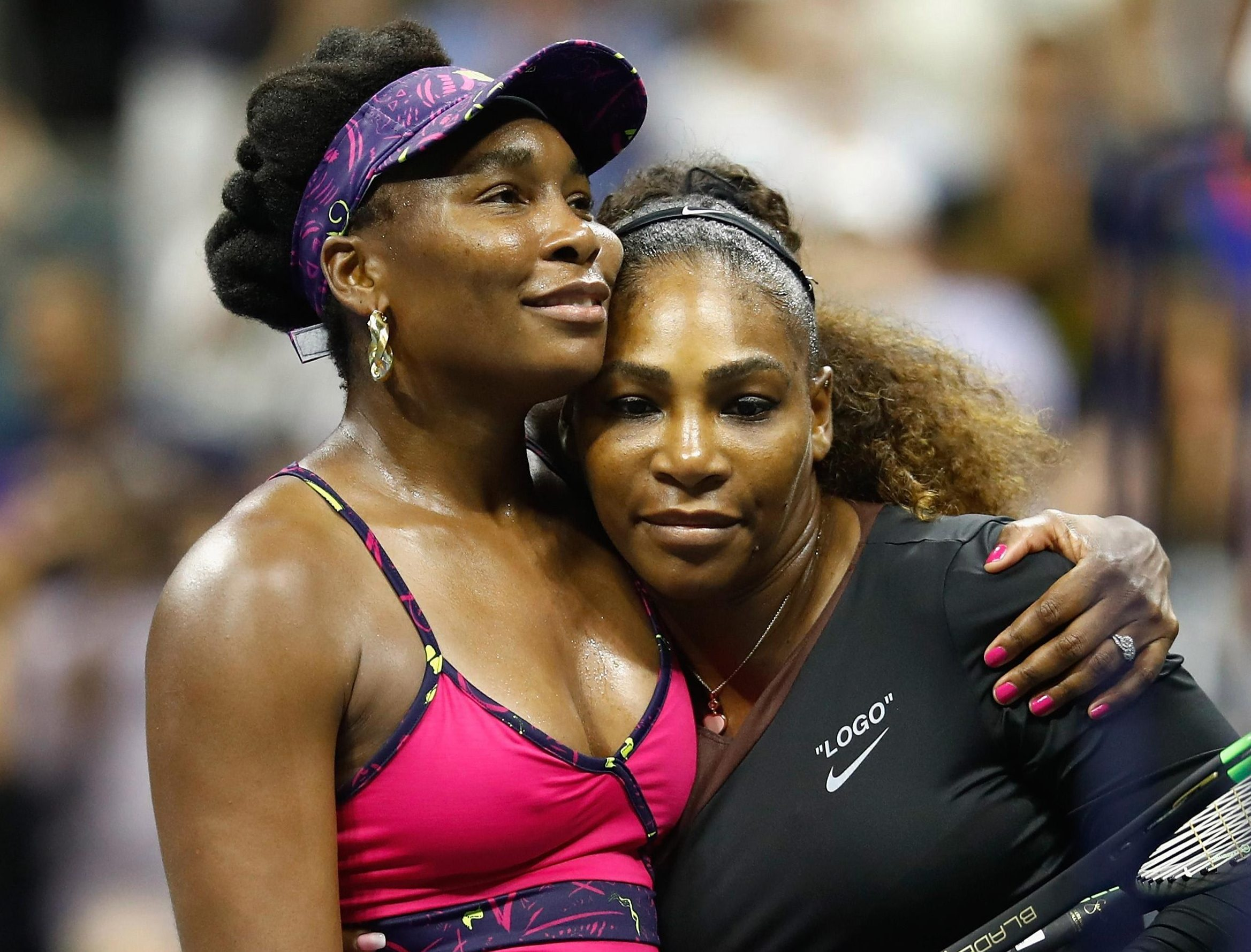 Serena Williams, right, is embraced by older sister Venus after beating her in just 72 minutes at the US Open