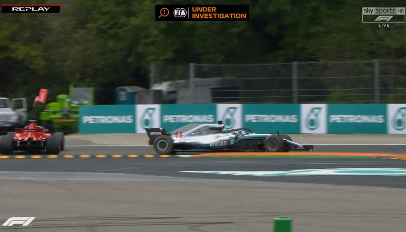 A piece of Ferrari bodywork flies into the air as Vettel spins out at the fourth corner