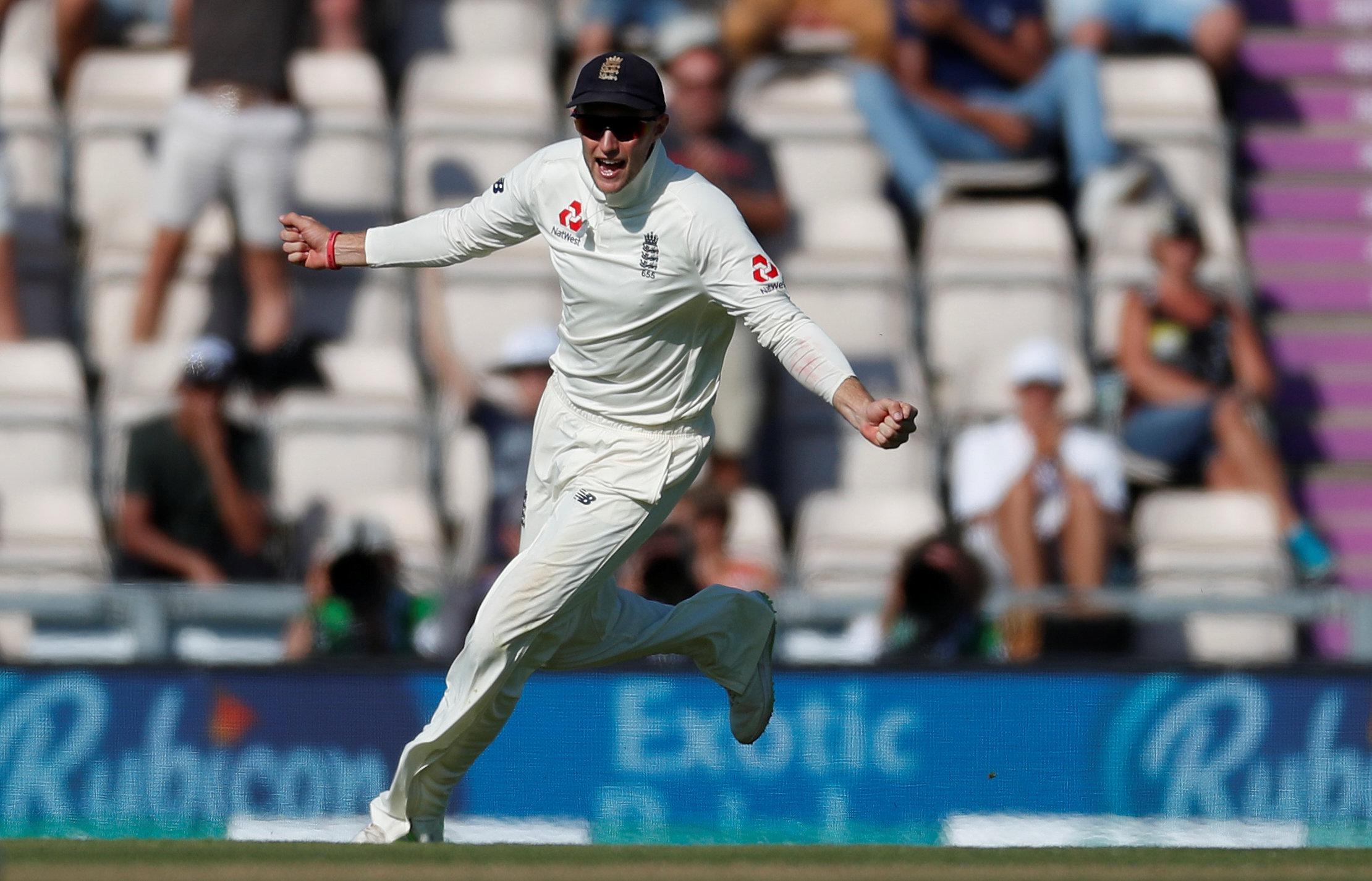 Joe Root celebrates taking the catch to dismiss India's Hardik Pandya
