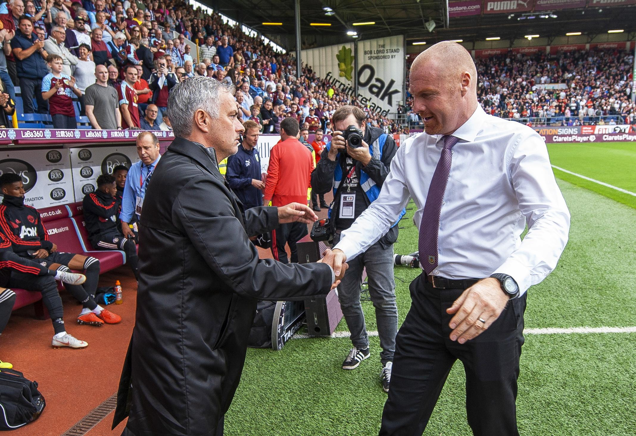 Jose Mourinho embraces opposite number Sean Dyche before kick off