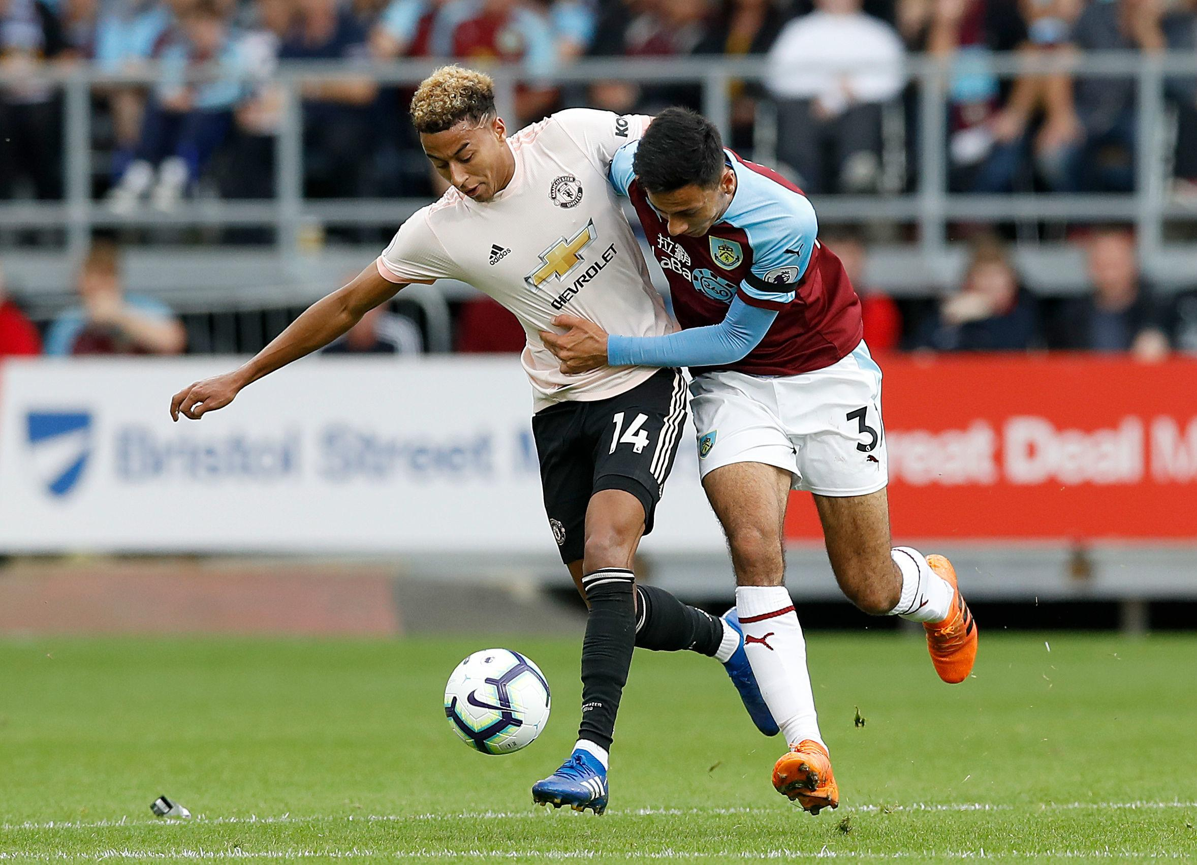 Manchester United's Jesse Lingard (left) and Burnley's Dwight McNeil battle for the ball