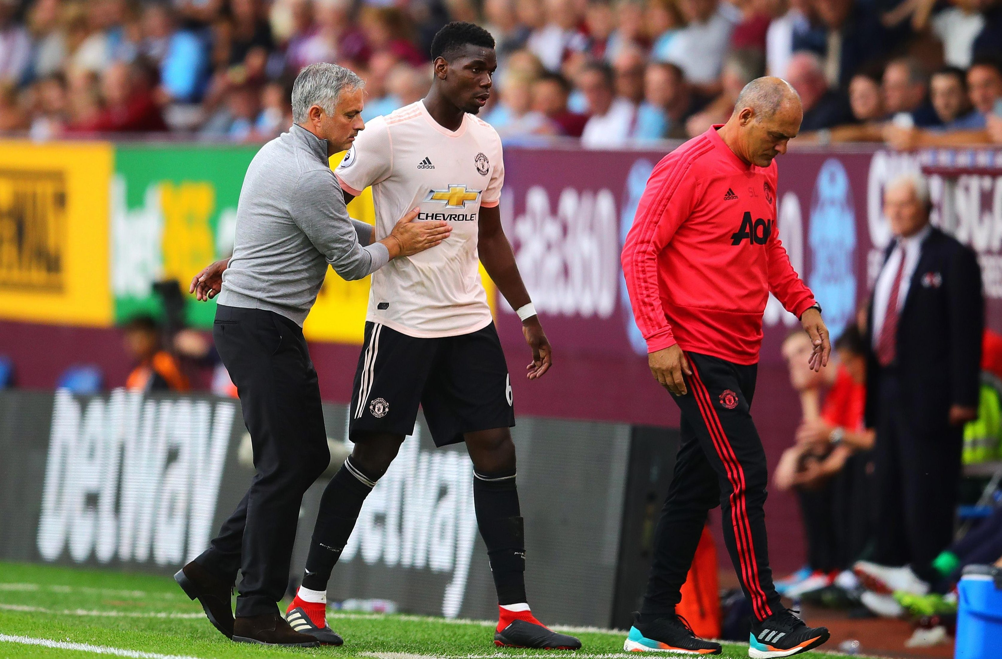 Pogba, middle, and Mourinho's, left, relationship has been put under increased scrutiny this season