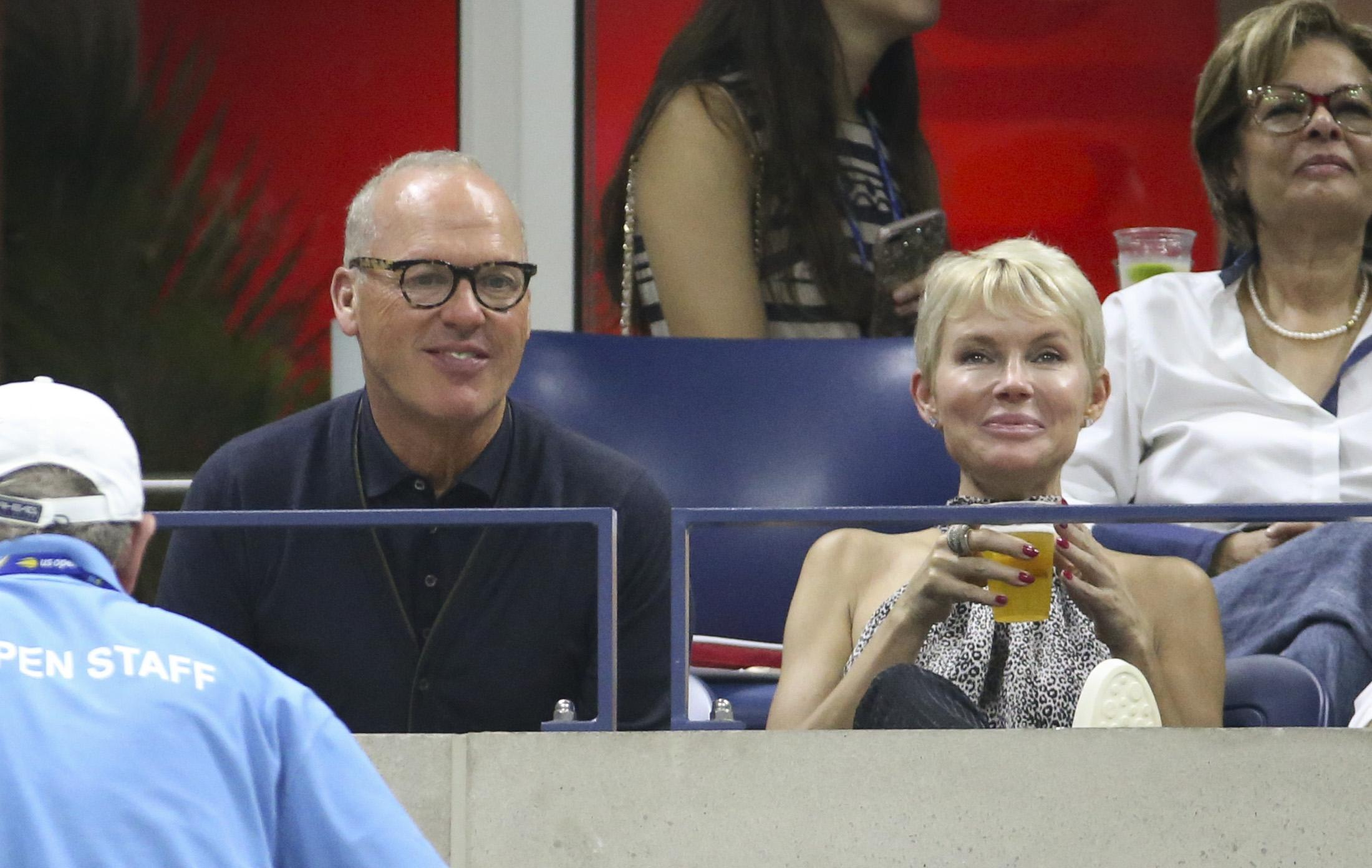 Actor Michael Keaton watches Serena Williams in action at the US Open