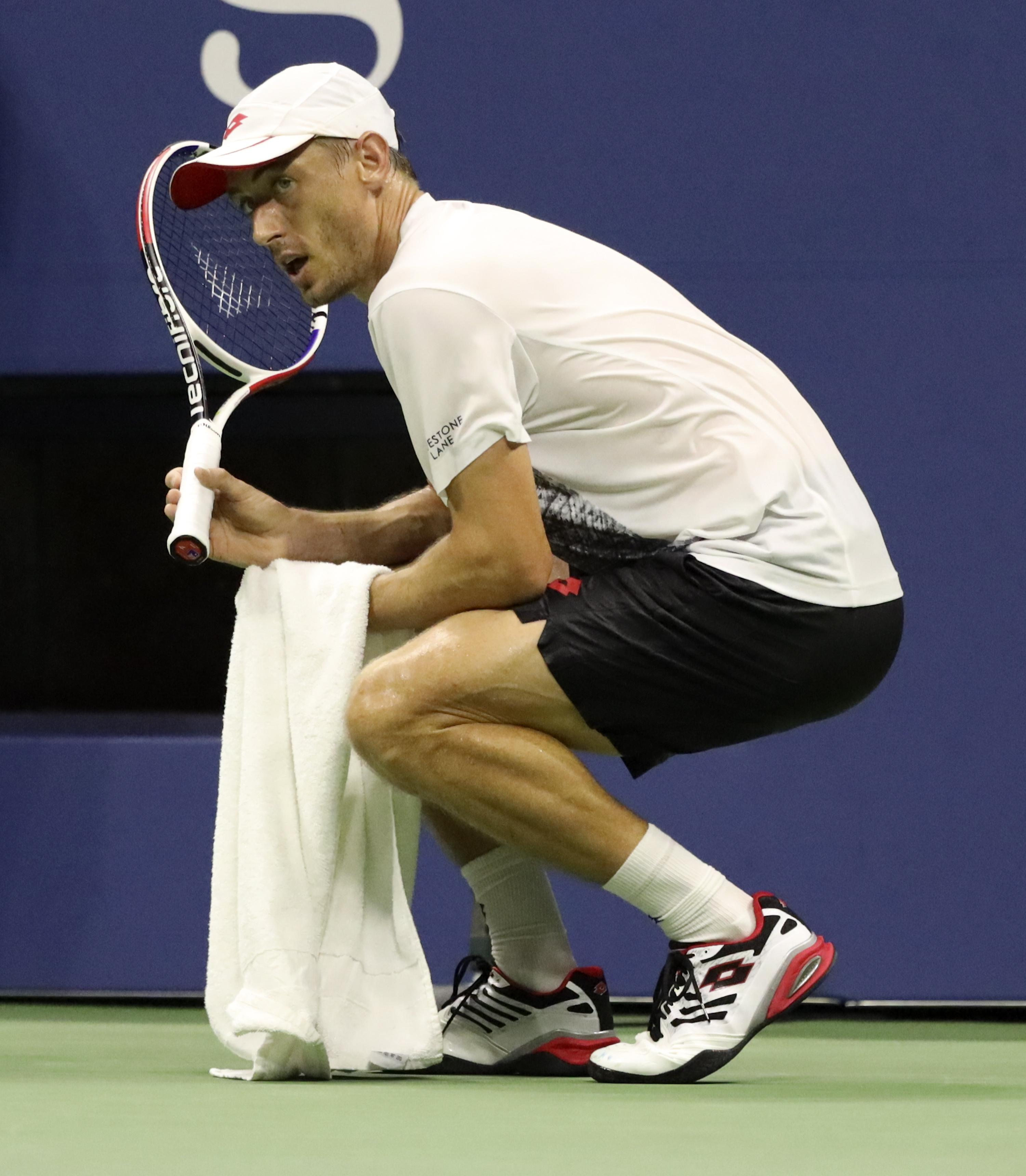 Aussie John Millman asked for permission to leave the court due as sweat made the ground slippery