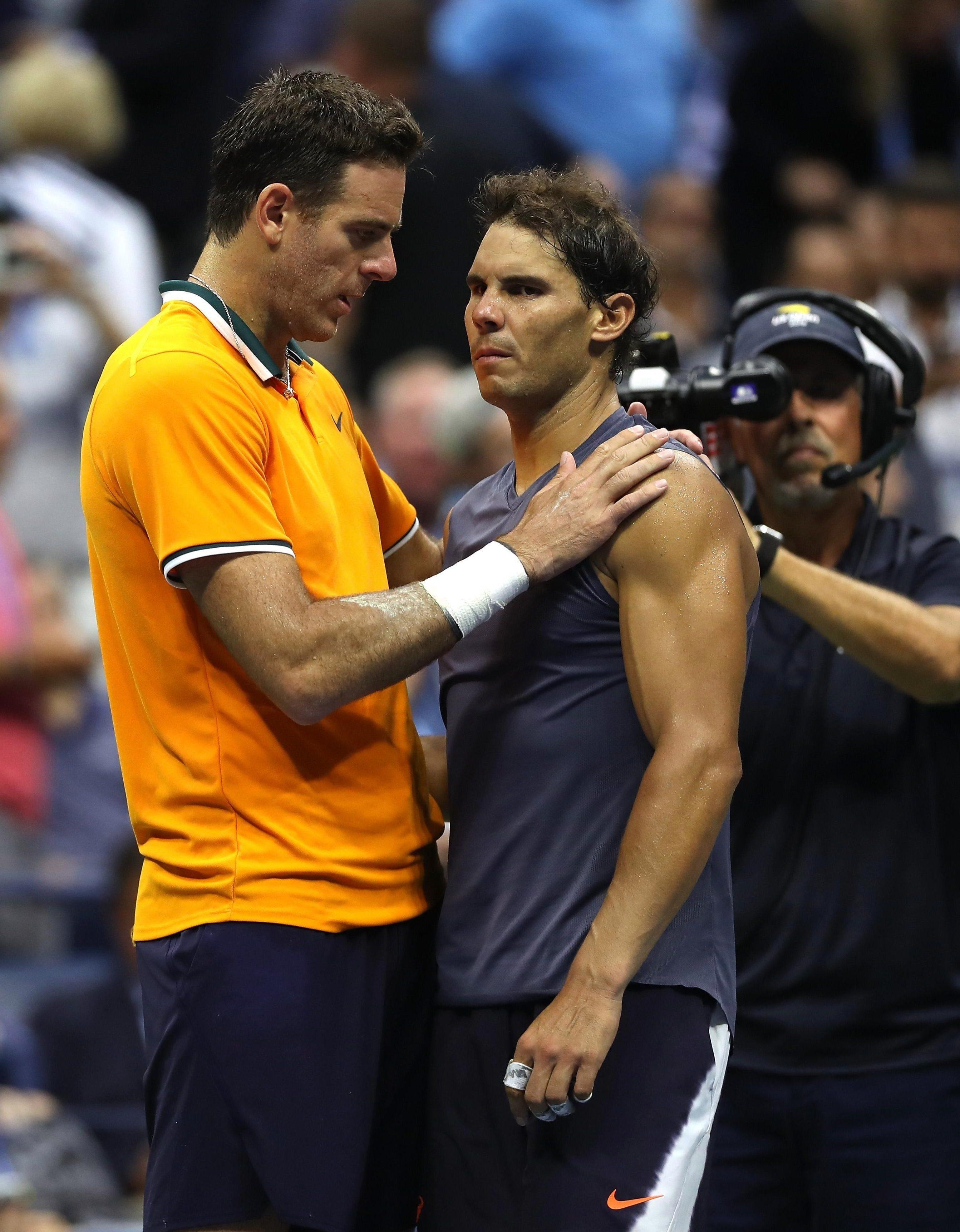 Juan Martin del Potro consoles Rafael Nadal following the match
