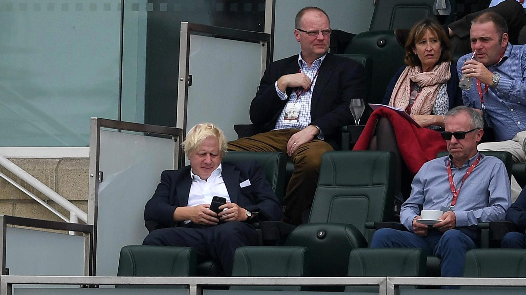 The former Mayor of London played on his phone while the action unfolded at the Oval