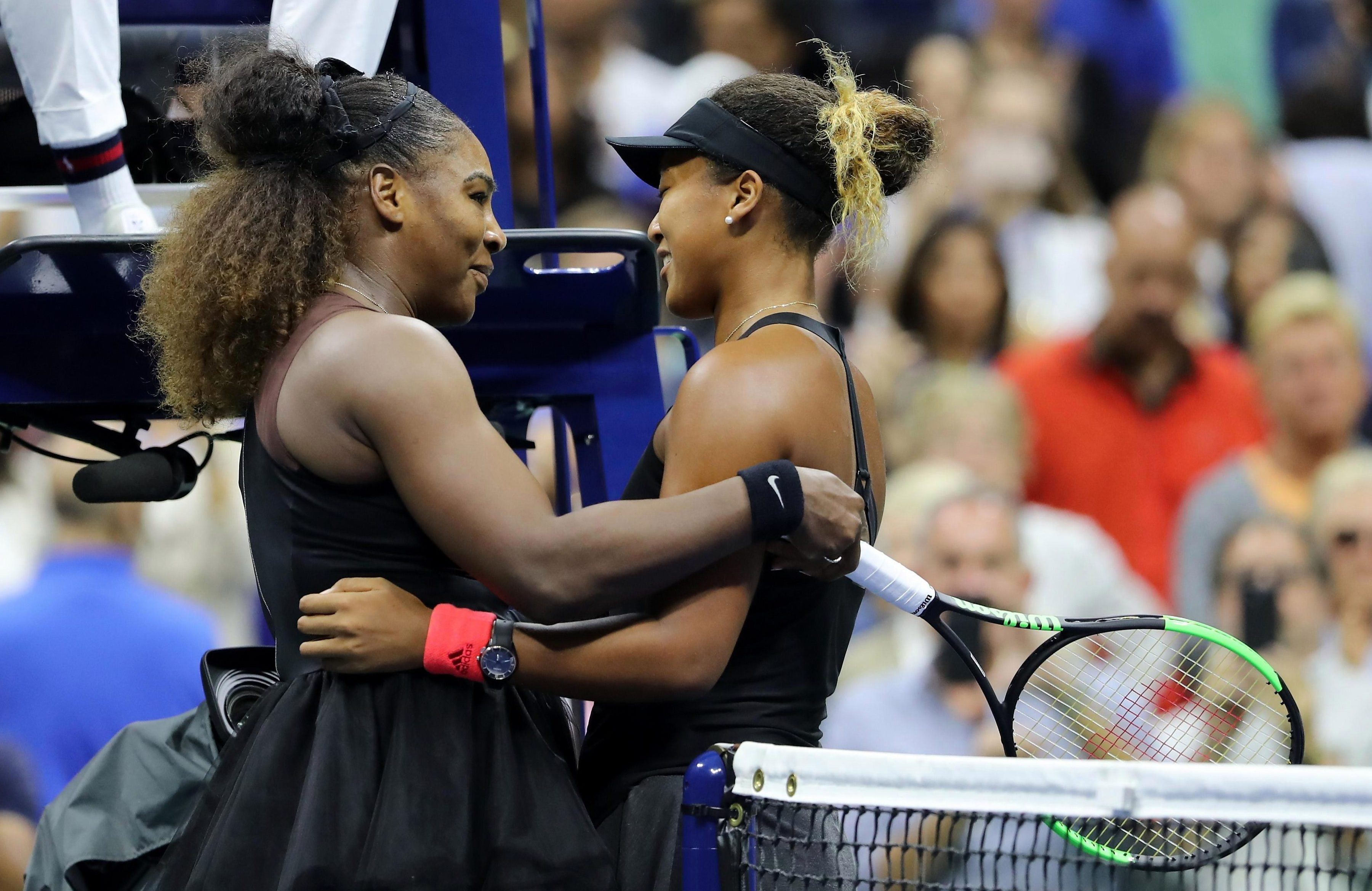 Serena Williams and Naomi Osaka embrace each other after their US Open final