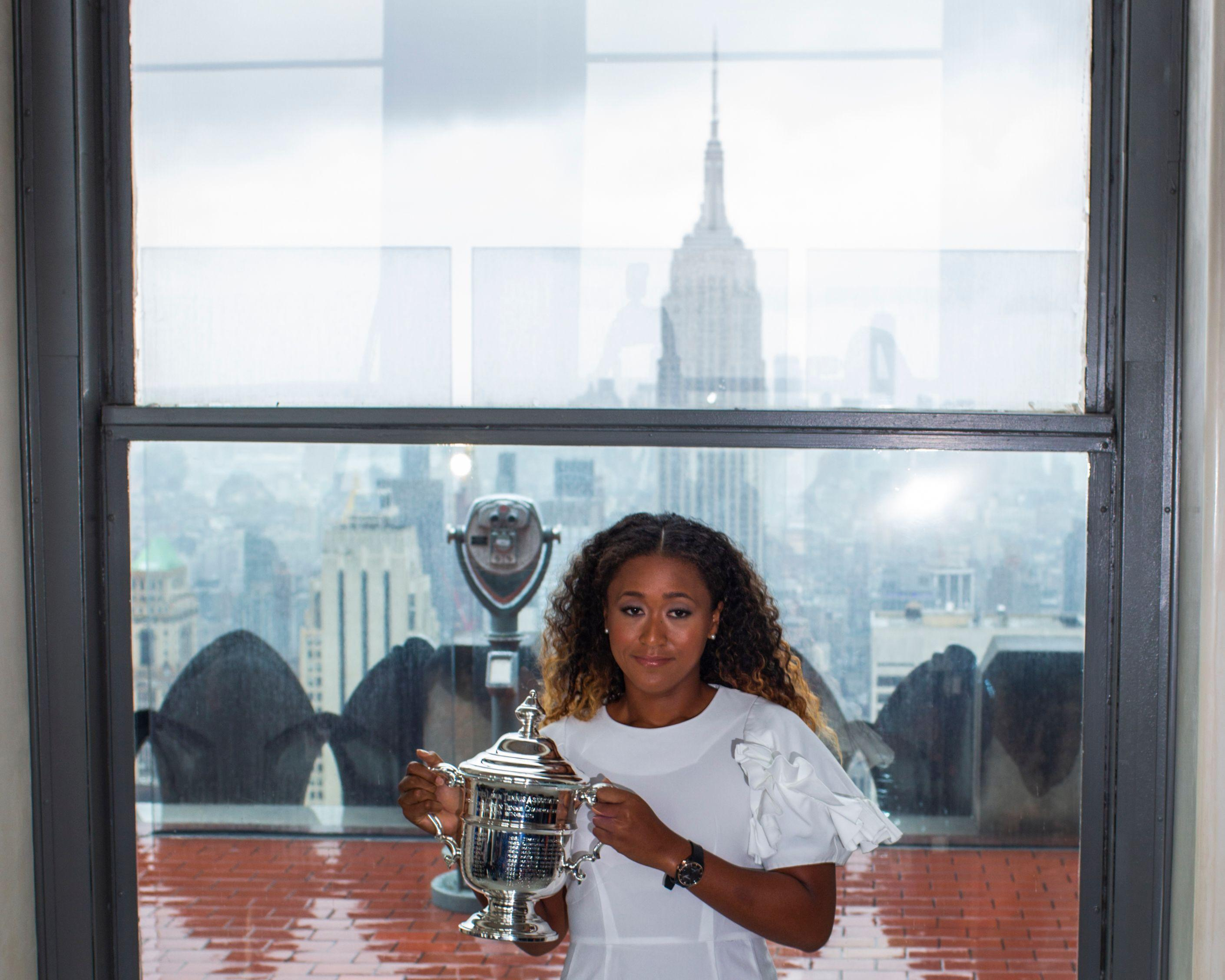 Osaki poses with the trophy at the Top of the Rock Observatory the day after winning the US Open