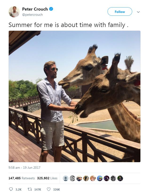 The6ft 7in striker posted a photo of himself on holiday feeding some giraffes