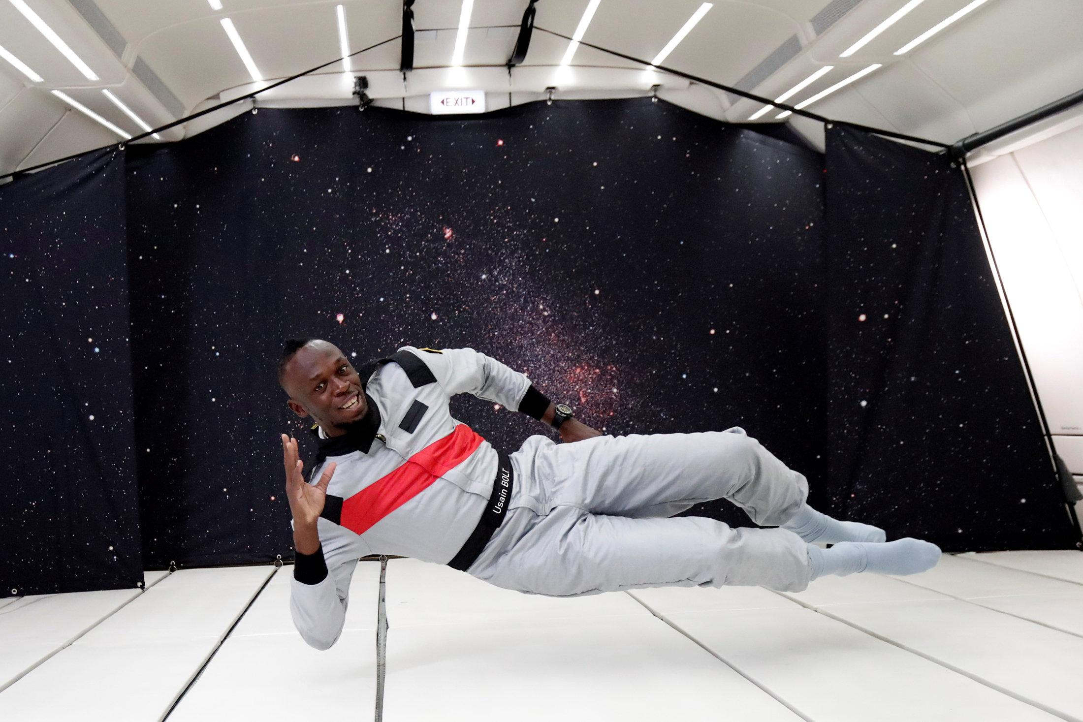 Usain Bolt shows it is worth the weightlessness as he enjoys time in zero gravity