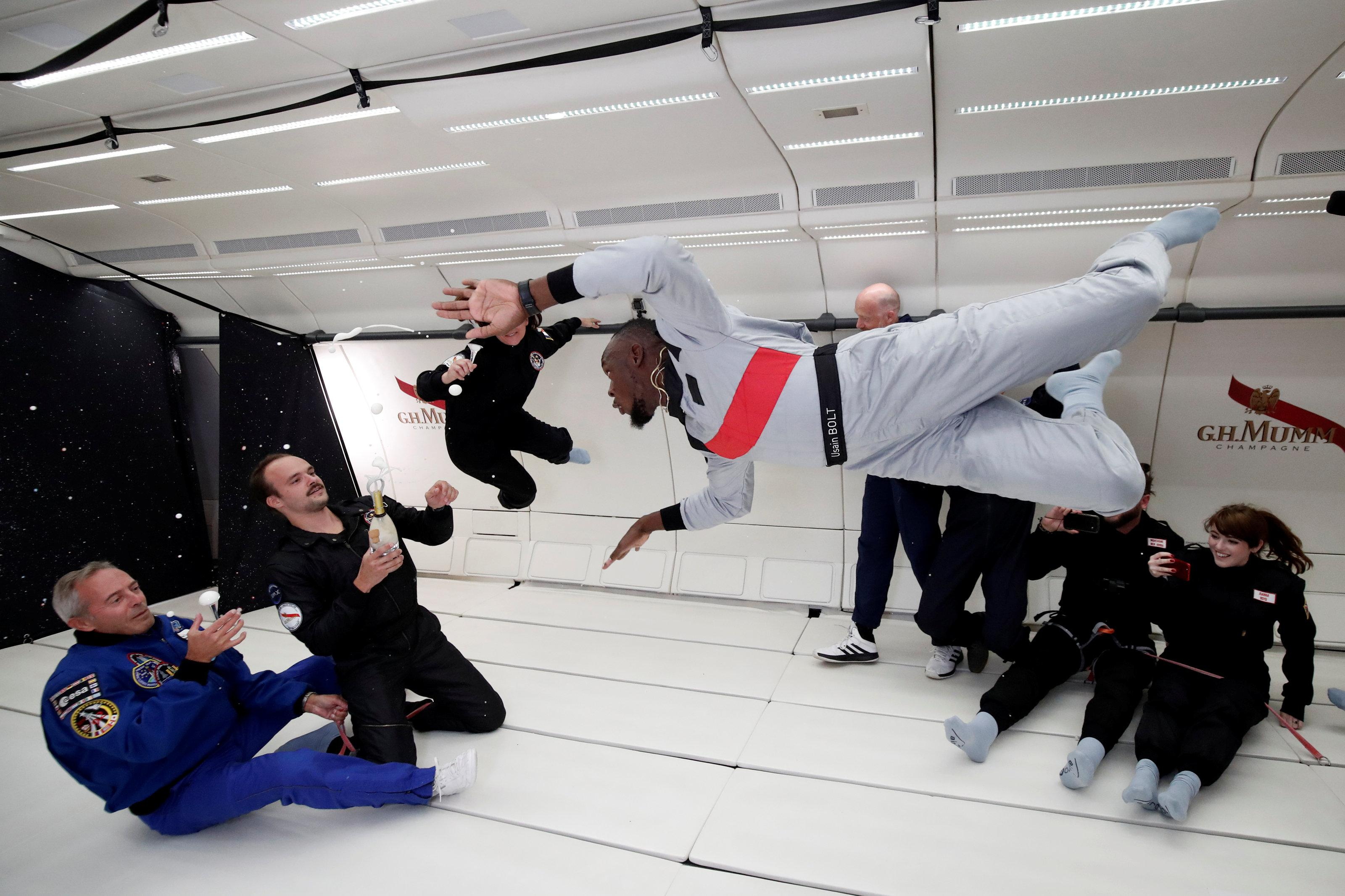 Usain Bolt is off to a flier again as he zooms around in a Moon-like environment