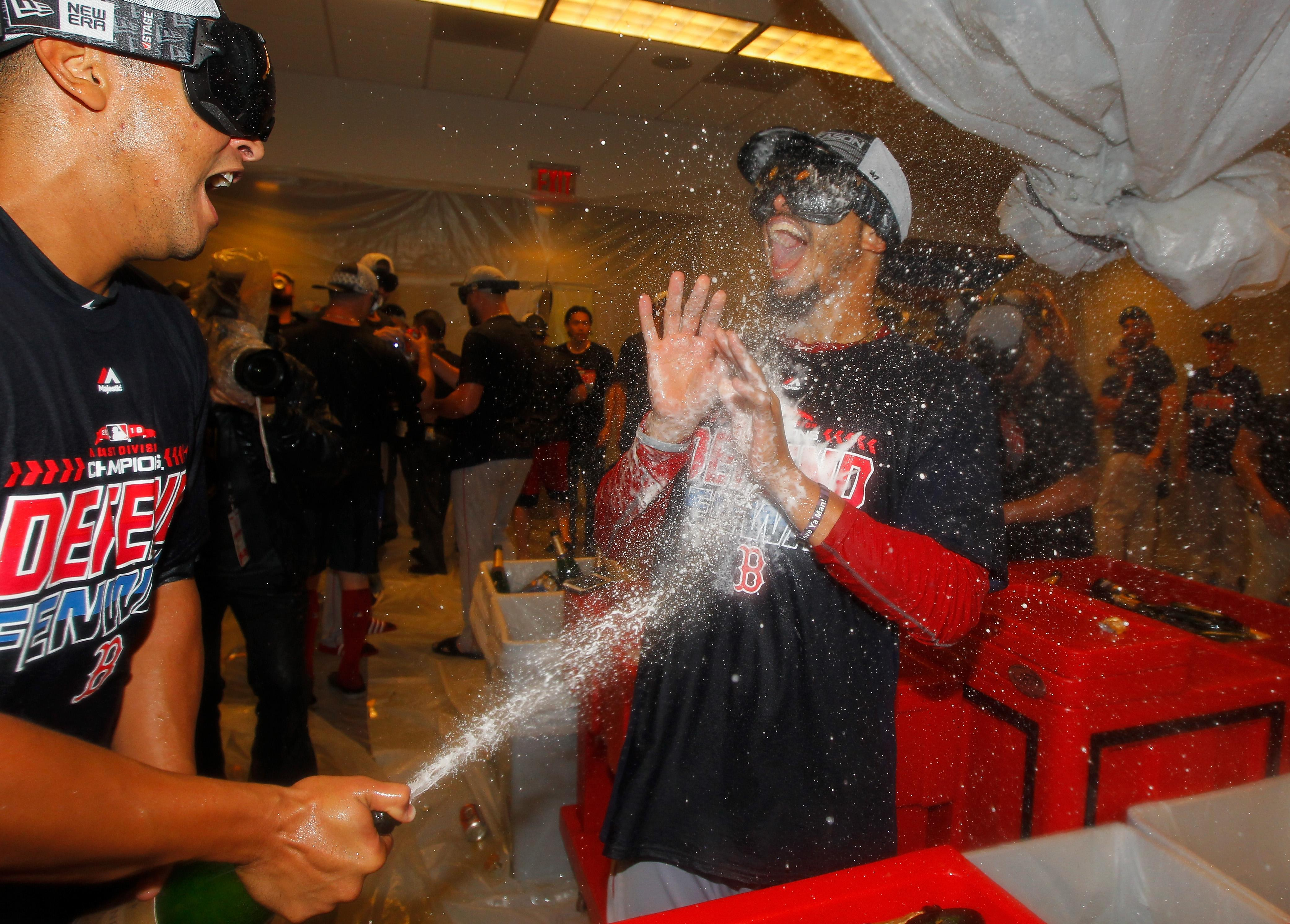 Boston Red Sox players let loose with their champagne after full-time