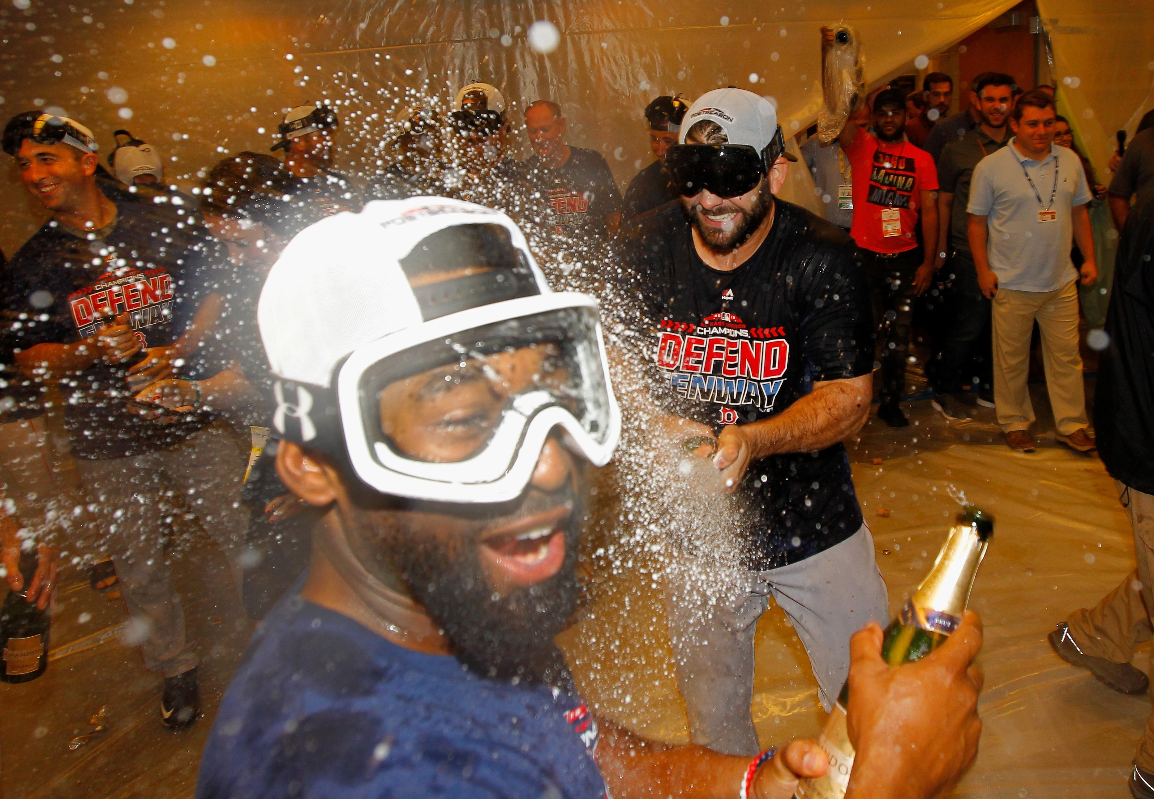 Boston Red Sox players protect their eyes from champagne with goggles
