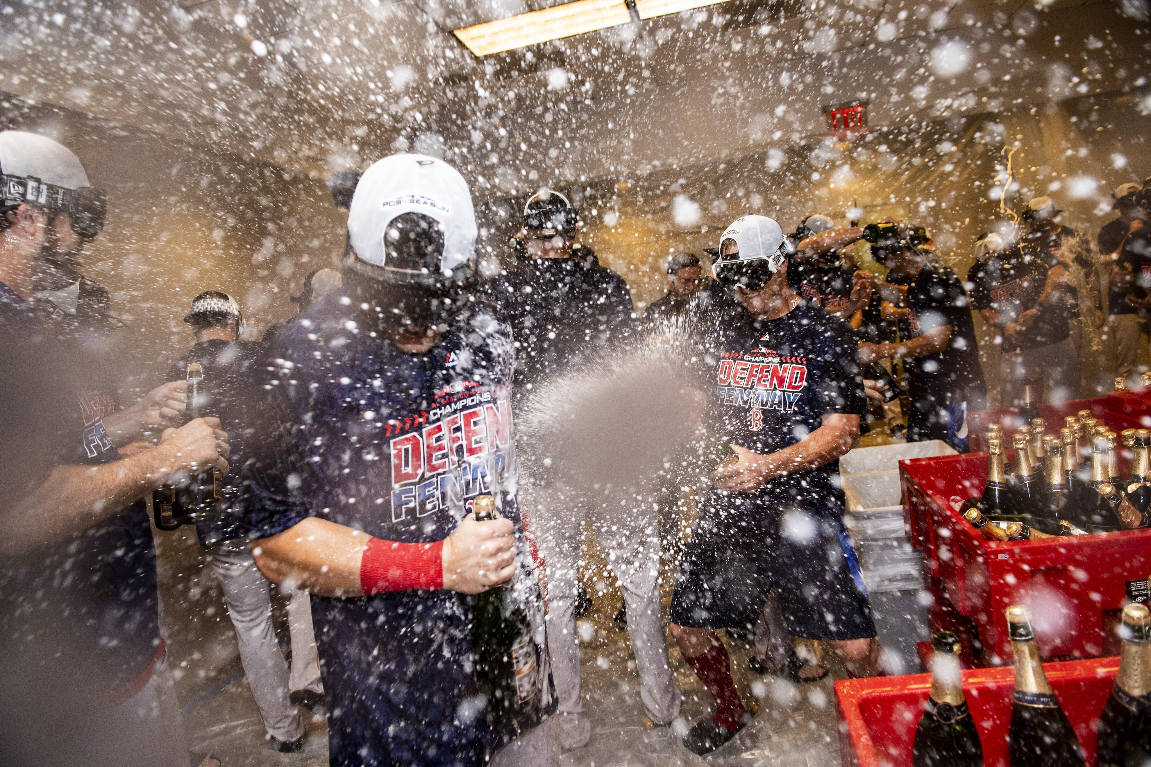The Boston Red Sox celebrated their title win by spraying champagne all over the clubhouse