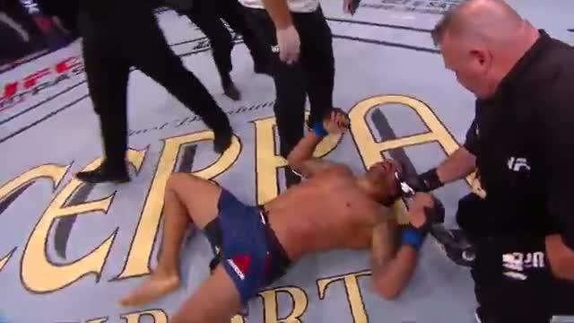 Eryk Anders collapsed to the ground in exhaustion after his defeat toThiago Santos