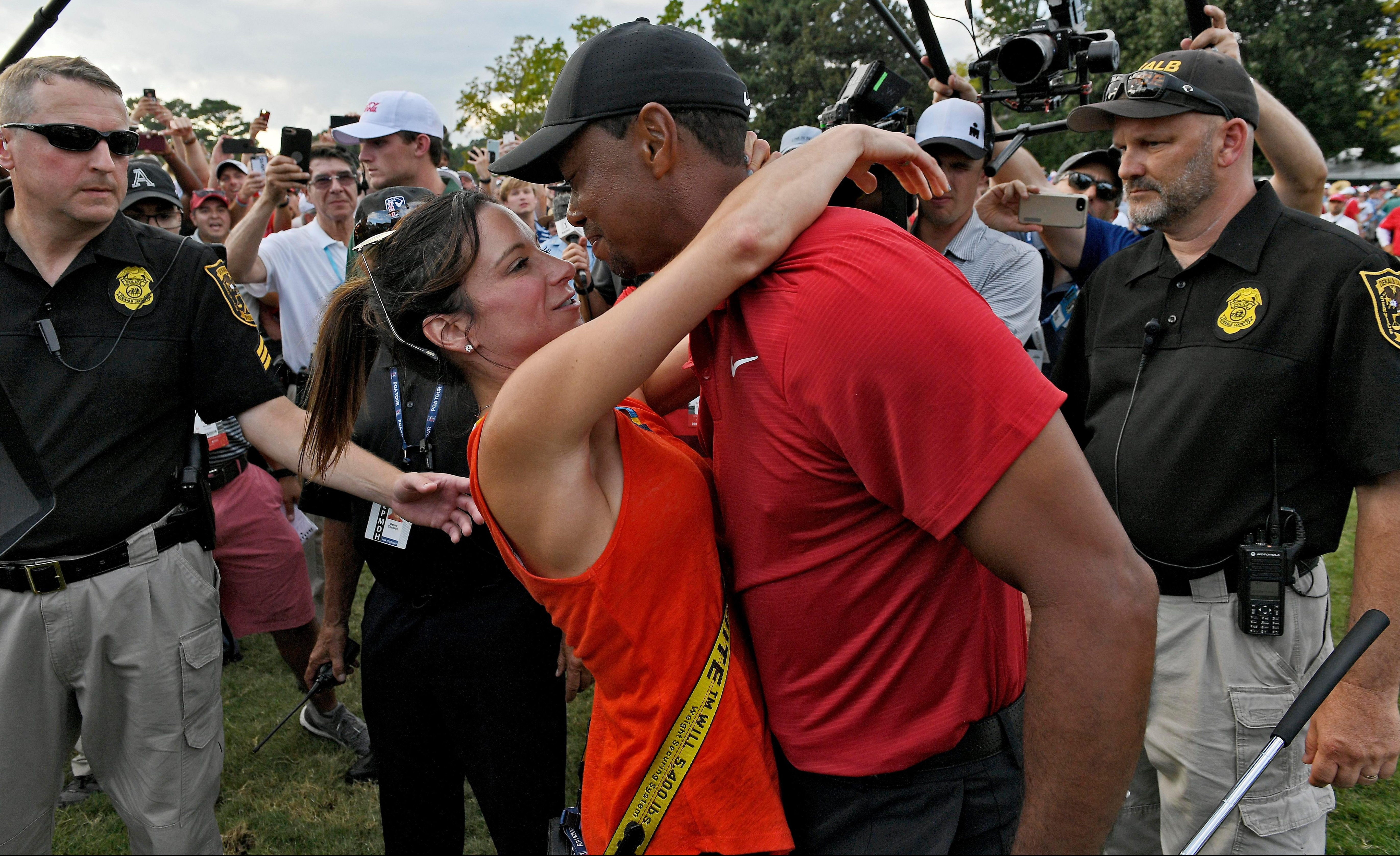 Tiger Woods and girlfriend Erica Herman celebrate his triumph at East Lake