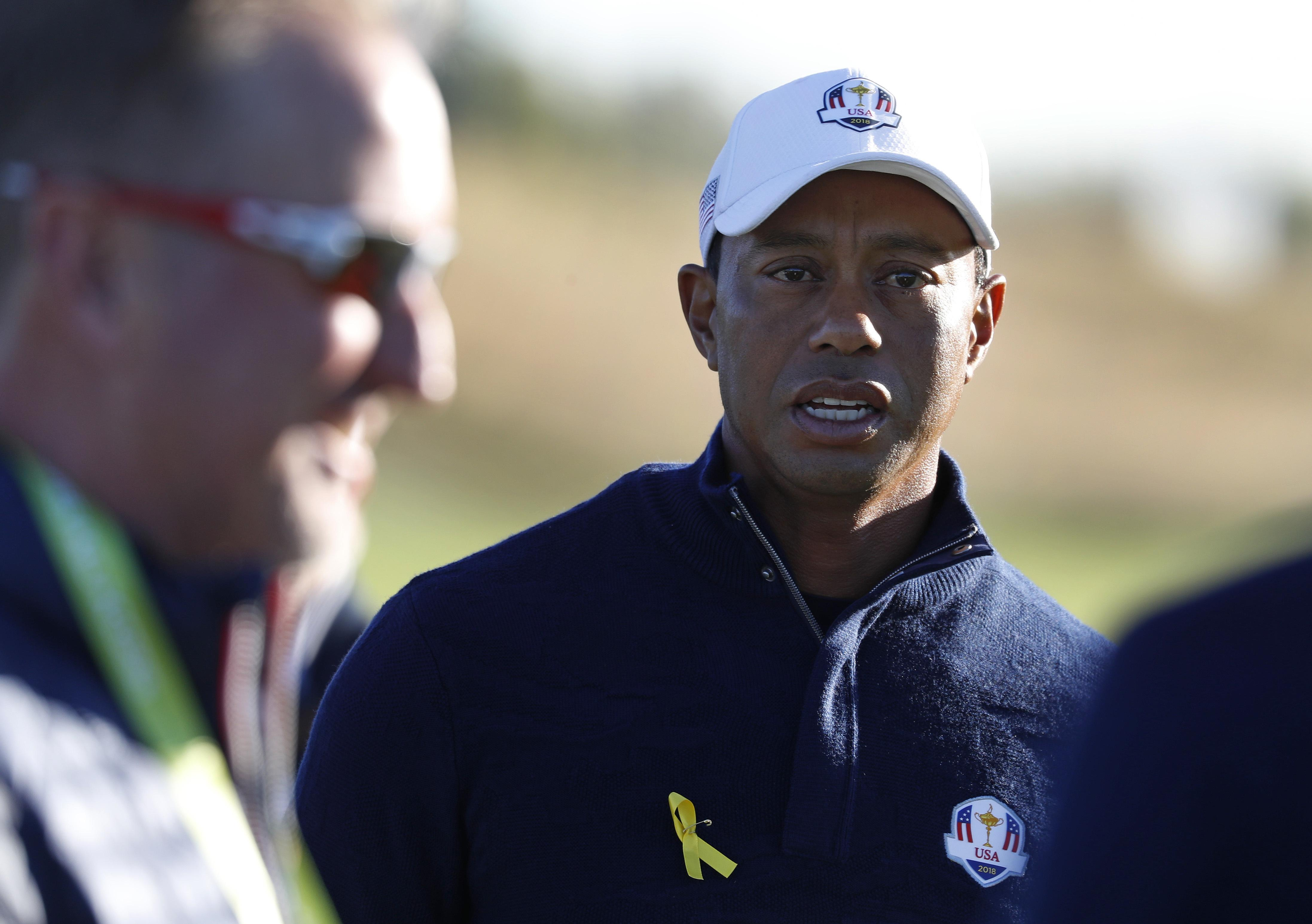Tiger Woods seen wearing a yellow ribbon ahead of the tournament