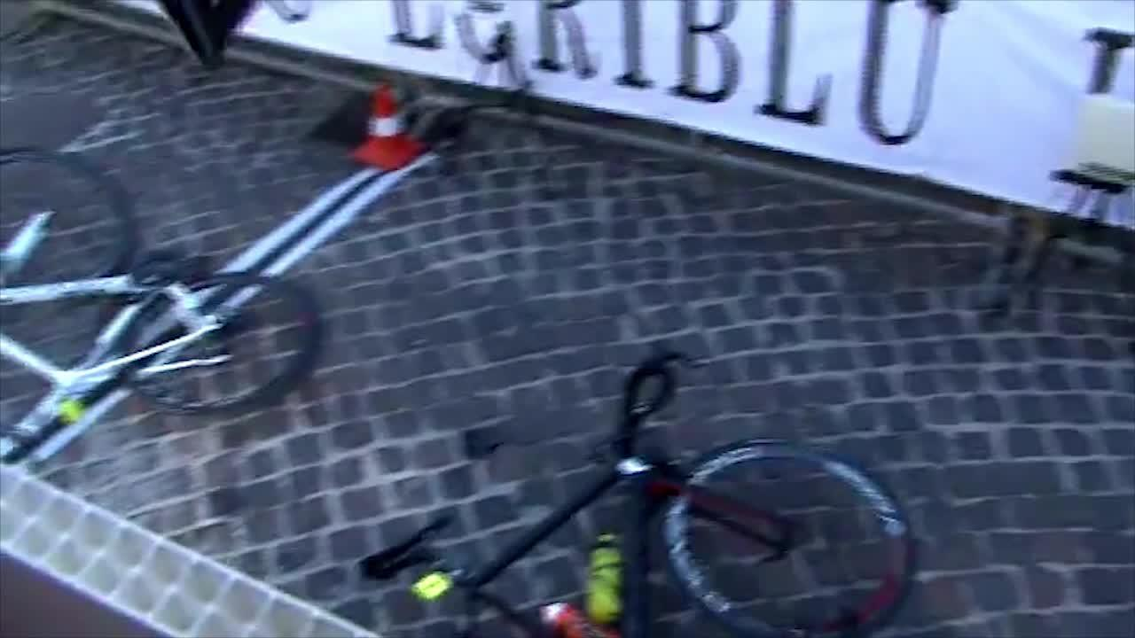 The cyclists are sent flying through the air and over the finish line