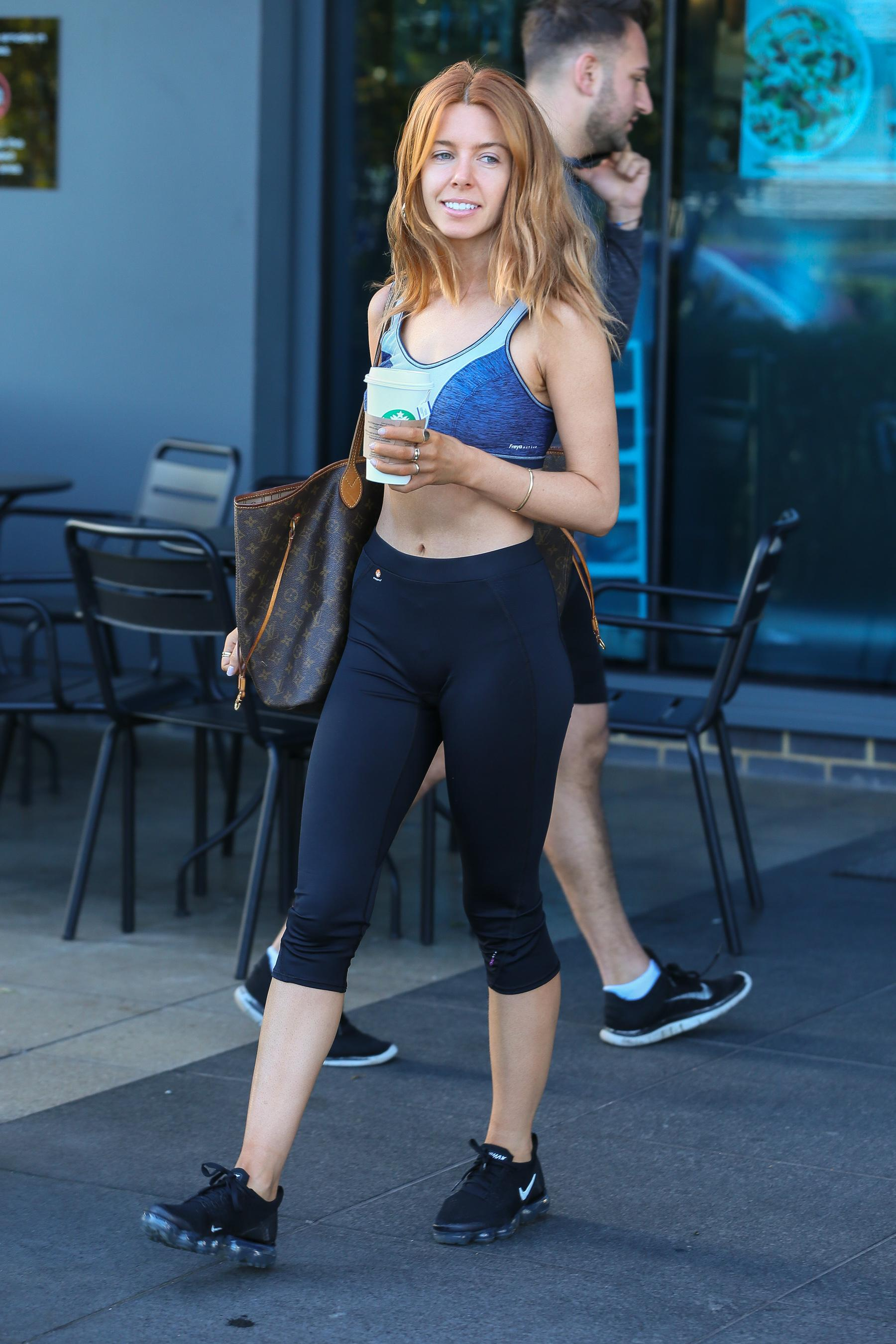 Strictlys Stacey Dooley shows off her toned tum in a